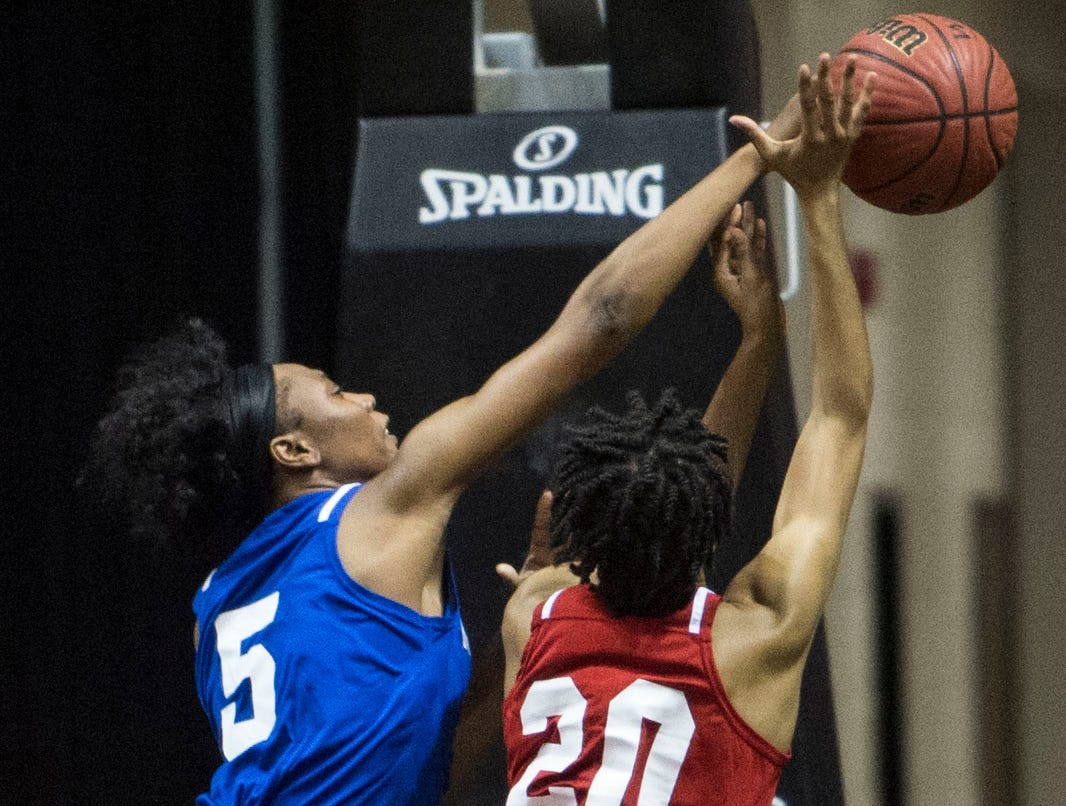 Alabama's Joiya Maddox (20) is blocked by Mississippi's Ebony Gayden (5) during the Alabama-Mississippi All-Star game at the Dunn-Oliver Acadome in Montgomery, Ala., on Friday, March 15, 2019. Alabama All-stars lead the Mississippi All-stars 48-34 at halftime.