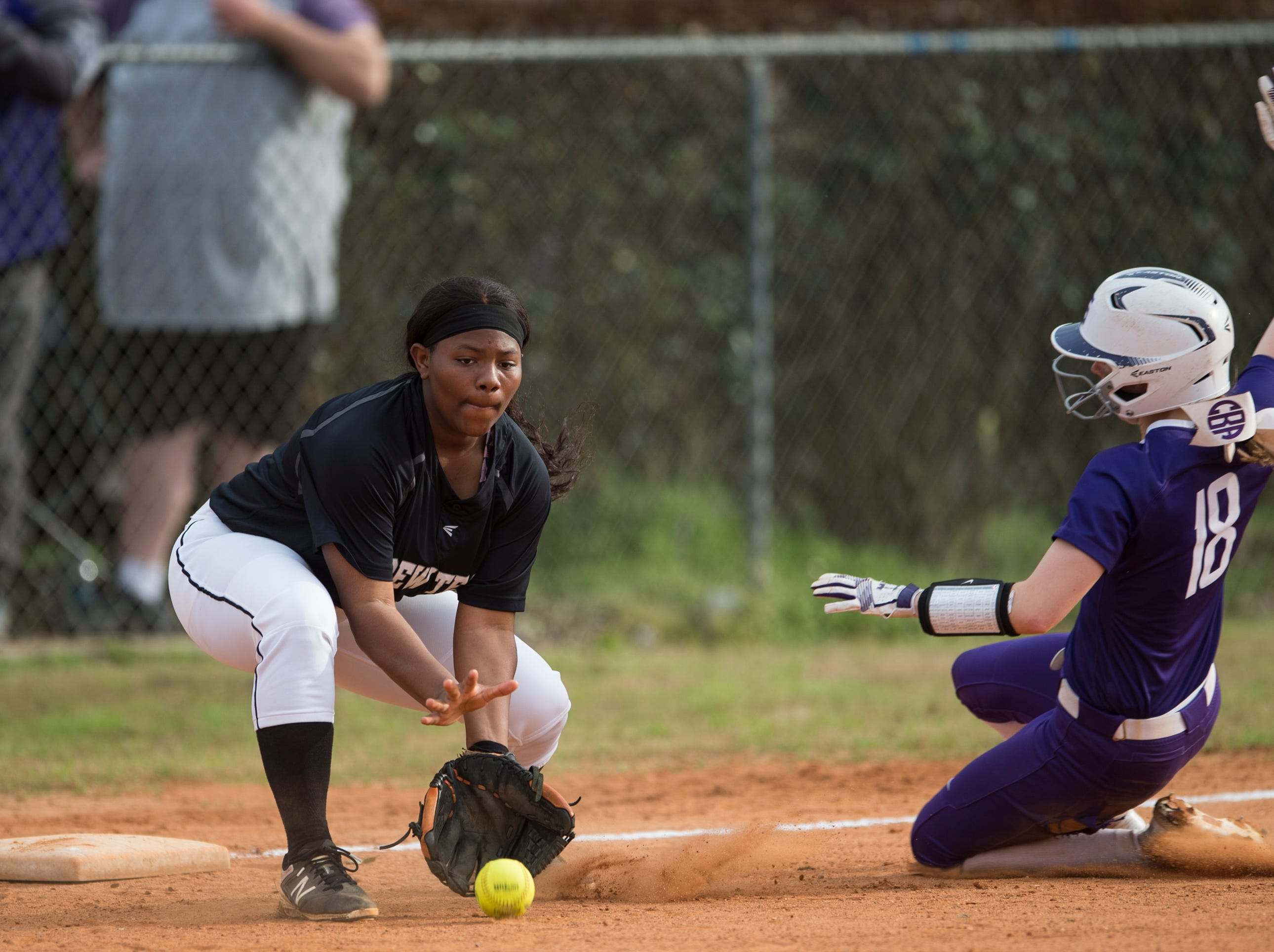 Tallassee's Chloe Baynes (18) slides safely into third base past Brew Tech's Janeen White (1) at Thompson Park in Montgomery, Ala., on Thursday, March 14, 2019. Tallassee defeated Brew Tech 7-0.