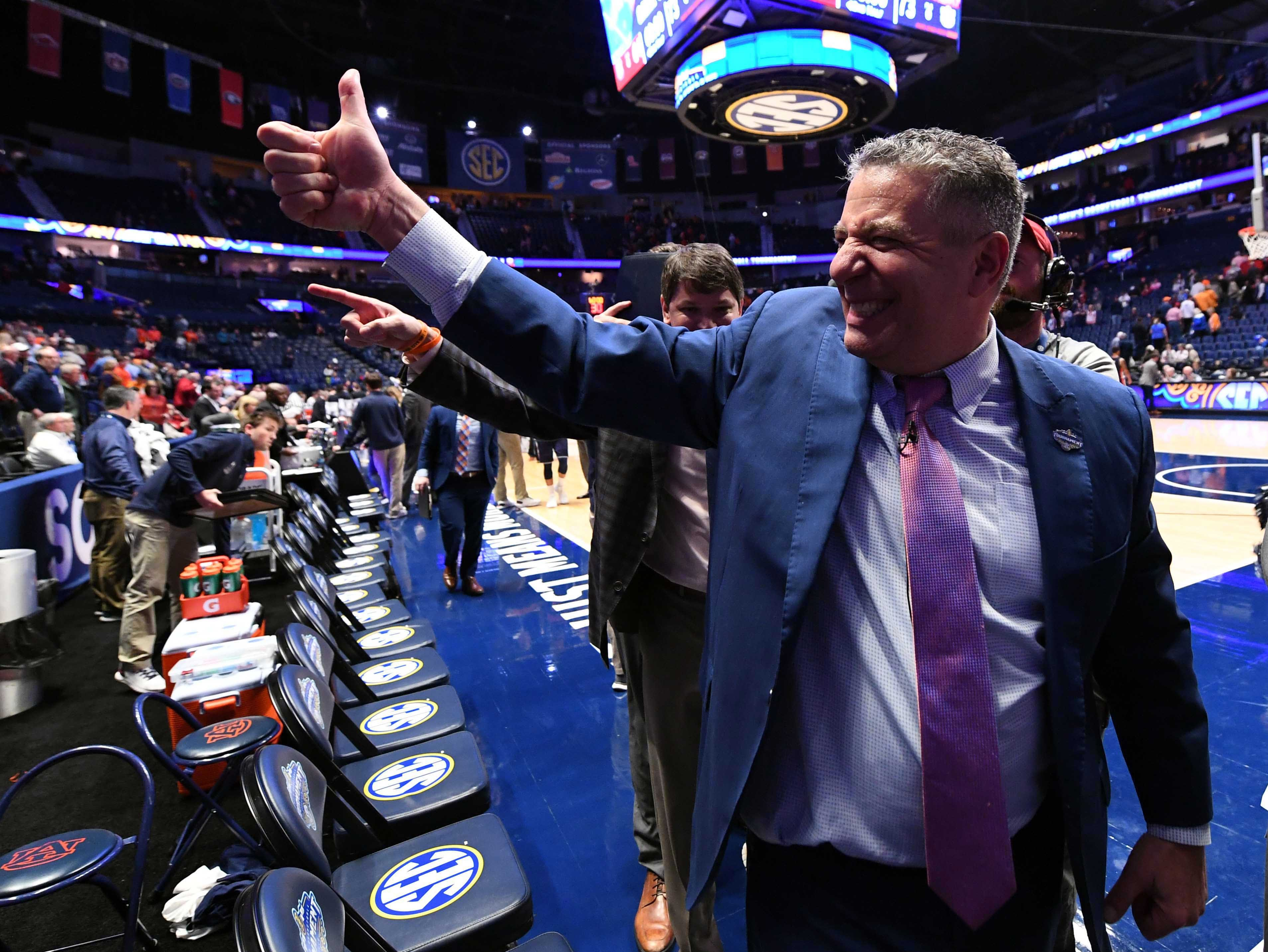 Mar 15, 2019; Nashville, TN, USA; Auburn Tigers head coach Bruce Pearl celebrates after a win against the South Carolina Gamecocks in the SEC conference tournament at Bridgestone Arena. Mandatory Credit: Christopher Hanewinckel-USA TODAY Sports