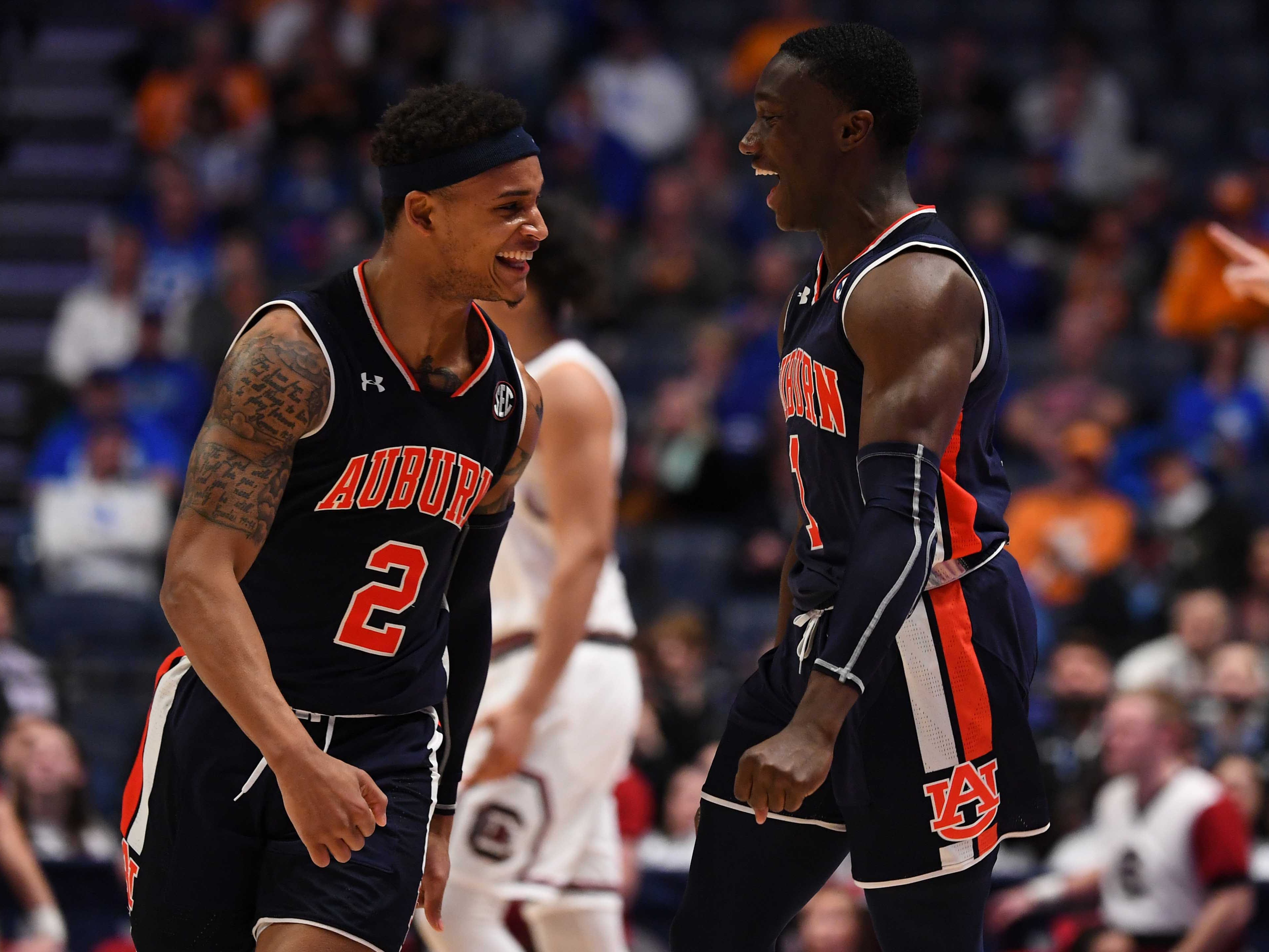 Auburn guard Jared Harper (1) and guard Bryce Brown (2) celebrate after a basket against South Carolina during the SEC Tournament on March 15, 2019, in Nashville, Tenn.