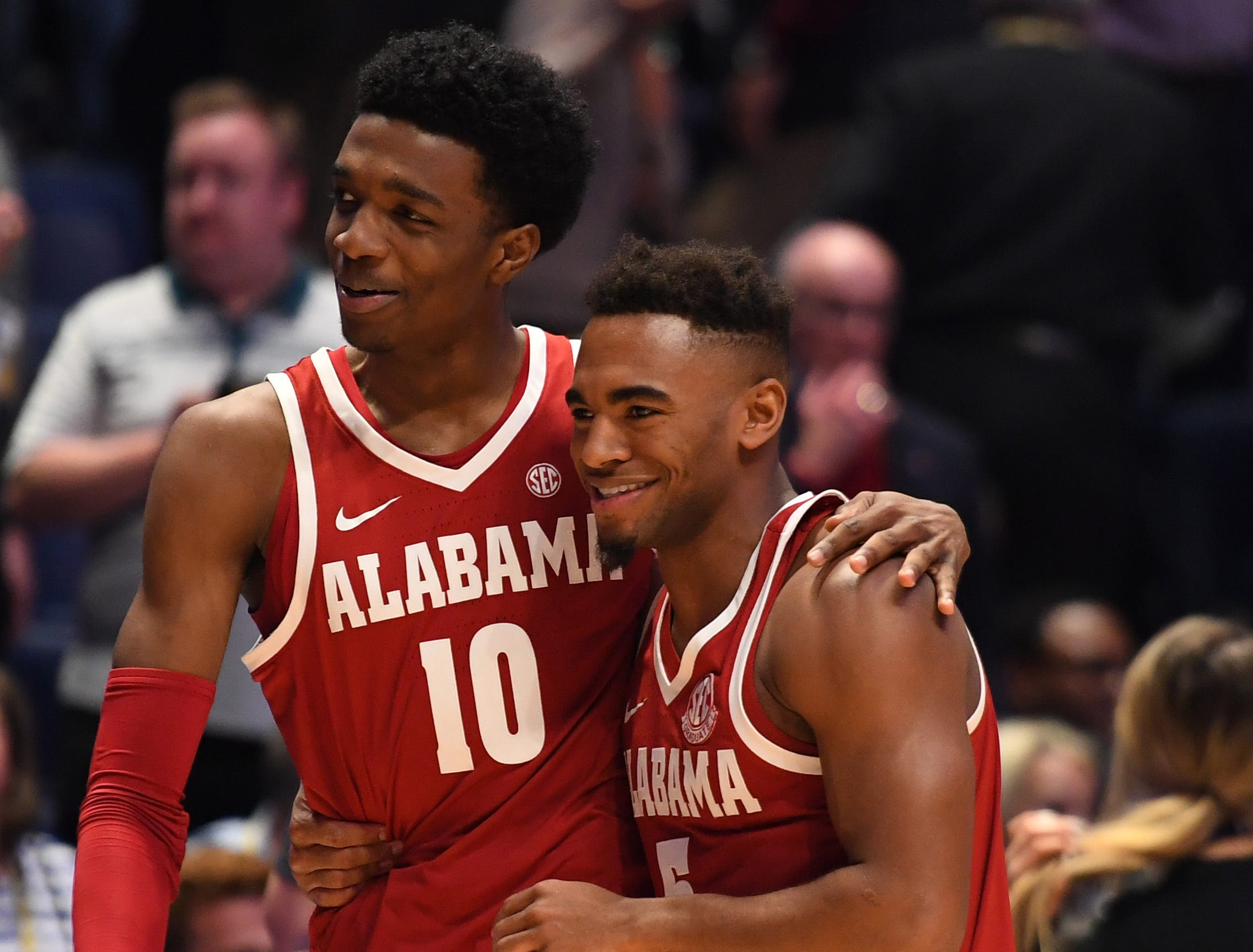 Mar 14, 2019; Nashville, TN, USA; Alabama Crimson Tide guard Herbert Jones (10) and Alabama Crimson Tide guard Avery Johnson Jr. (5) celebrate after a win against the Mississippi Rebels in the SEC conference tournament at Bridgestone Arena. Mandatory Credit: Christopher Hanewinckel-USA TODAY Sports