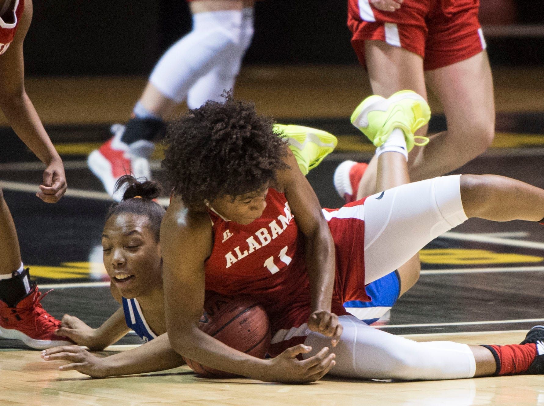 Mississippi's Keshuna Luckett (15) and Alabama's Jaylyn Sherrod (11) dive for a loose ball during the Alabama-Mississippi All-Star game at the Dunn-Oliver Acadome in Montgomery, Ala., on Friday, March 15, 2019. Alabama All-stars lead the Mississippi All-stars 48-34 at halftime.