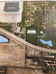 An application is pending to rezone 5.8 acres along Ind. 332 between the Meijer supercenter (top left) and the Muncie First Church of the Nazarene (above pond on right)