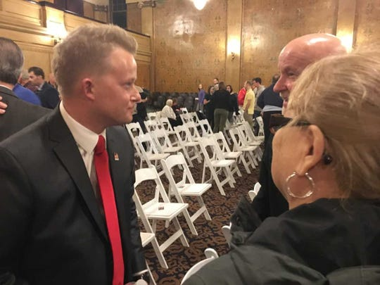 Nate Jones, talks to audience members after a mayoral debate on March 14.