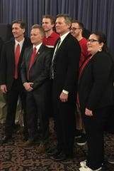 Mayoral hopefuls Dan Ridenour, far left, Nate Jones, middle, and Tom Bracken pose for photos with Ball State College Republicans, who hosted a debate on March 14.