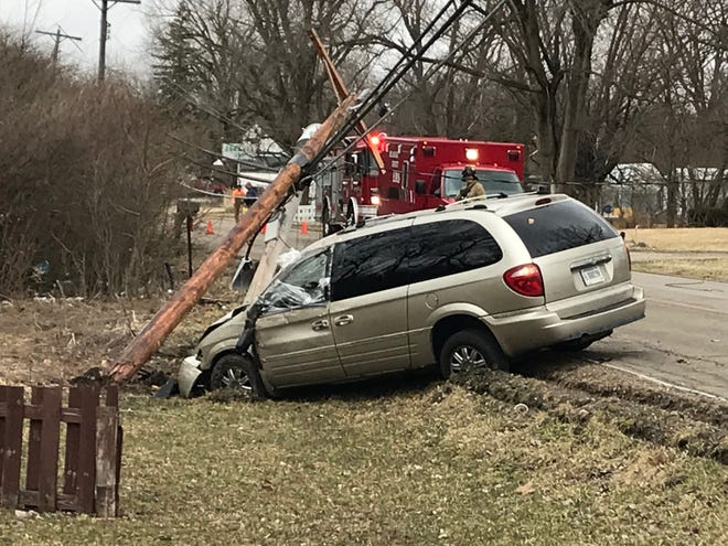 A van on Friday morning struck a utility pole on South Hoyt Avenue and brought down a power line that for a time prevented removal of the driver.