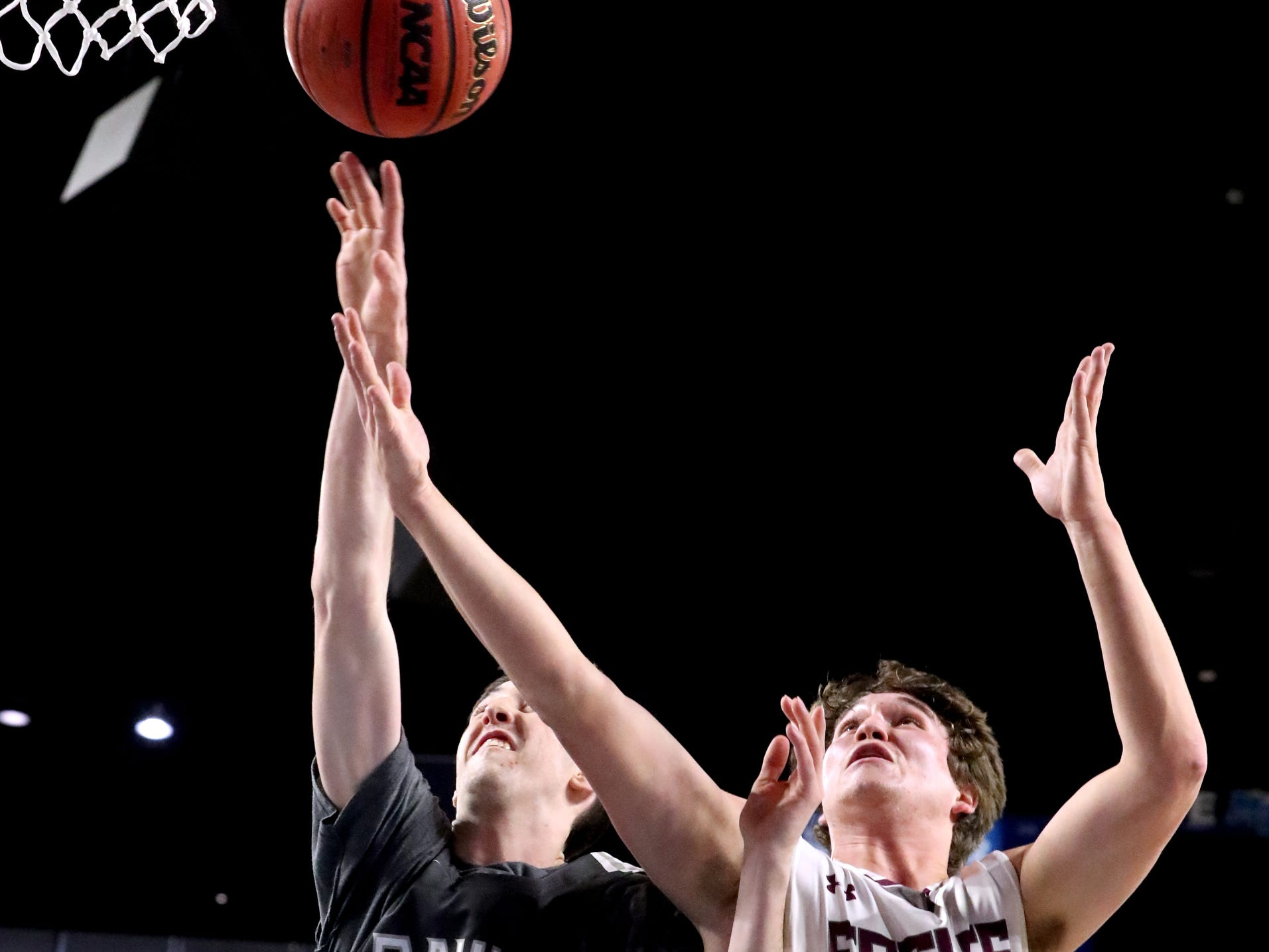 Columbia Academy's Eli Hyle (21) and Eagleville's Ethan Cobb (12) both go after a rebound and during the semifinal round of the TSSAA Class A Boys State Tournament, on Thursday, March 15, 2019, at Murphy Center in Murfreesboro, Tenn.