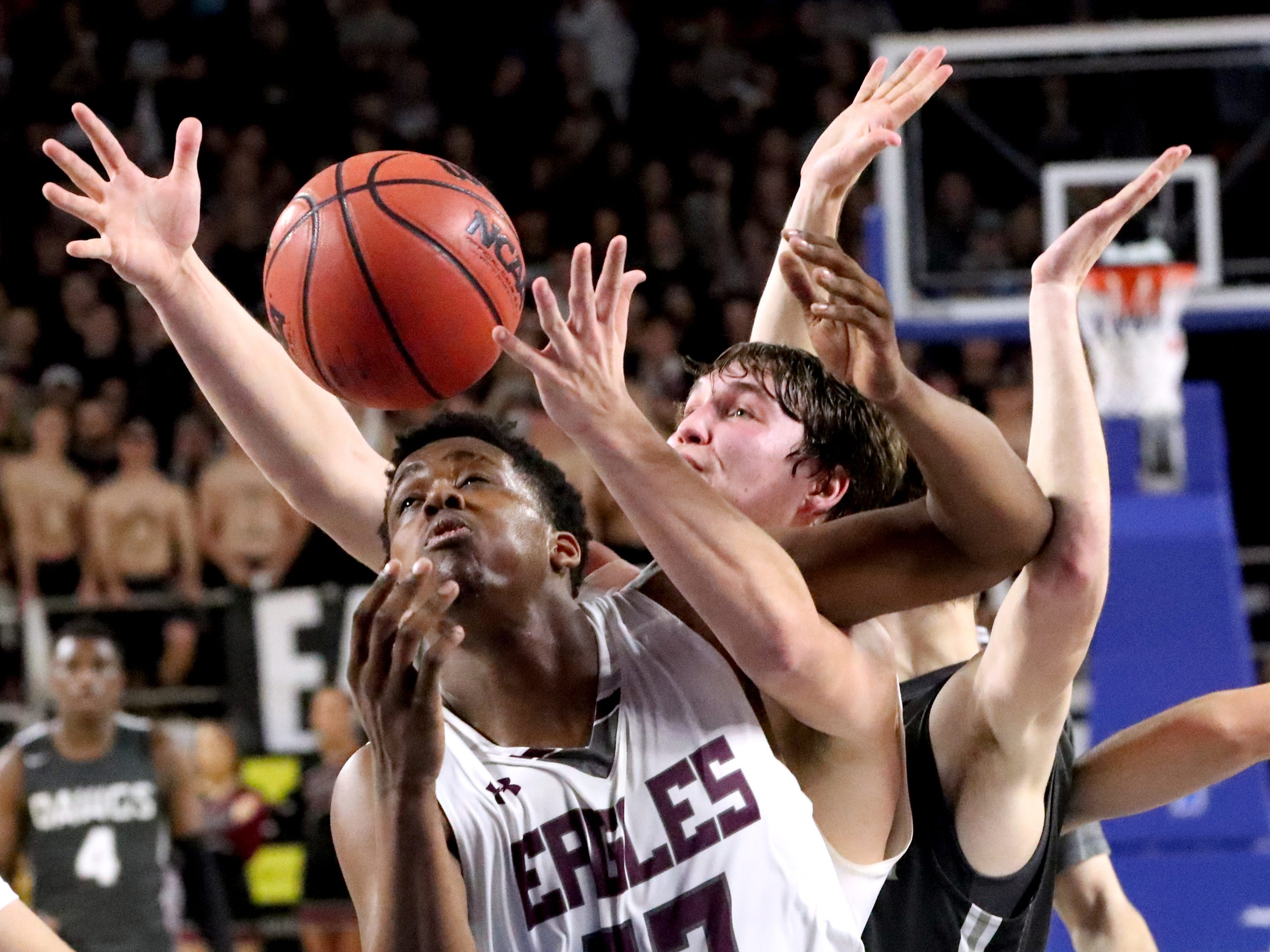 Eagleville's Demarious Stoudemire (33) and Eagleville's Ethan Cobb (12) both go after a rebound after a free throw during the semifinal round of the TSSAA Class A Boys State Tournament against Columbia Academy, on Thursday, March 15, 2019, at Murphy Center in Murfreesboro, Tenn.