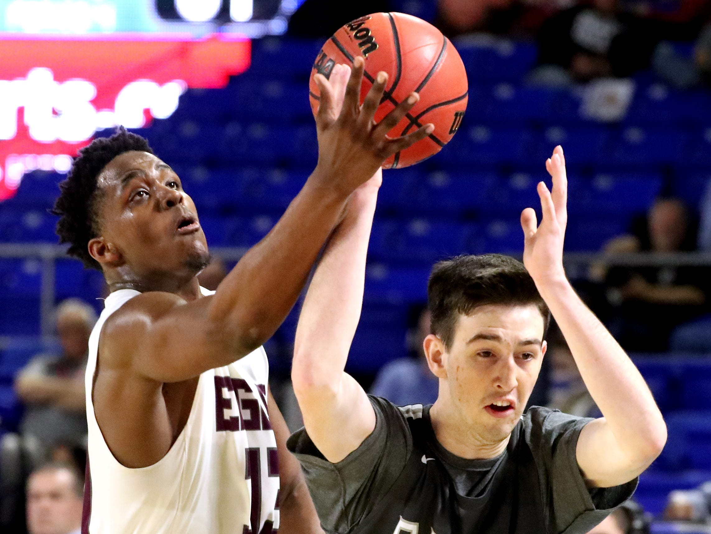 Eagleville's Demarious Stoudemire (33) tries to steal the ball away from Columbia Academy's Eli Hyle (21) during the semifinal round of the TSSAA Class A Boys State Tournament, on Thursday, March 15, 2019, at Murphy Center in Murfreesboro, Tenn.