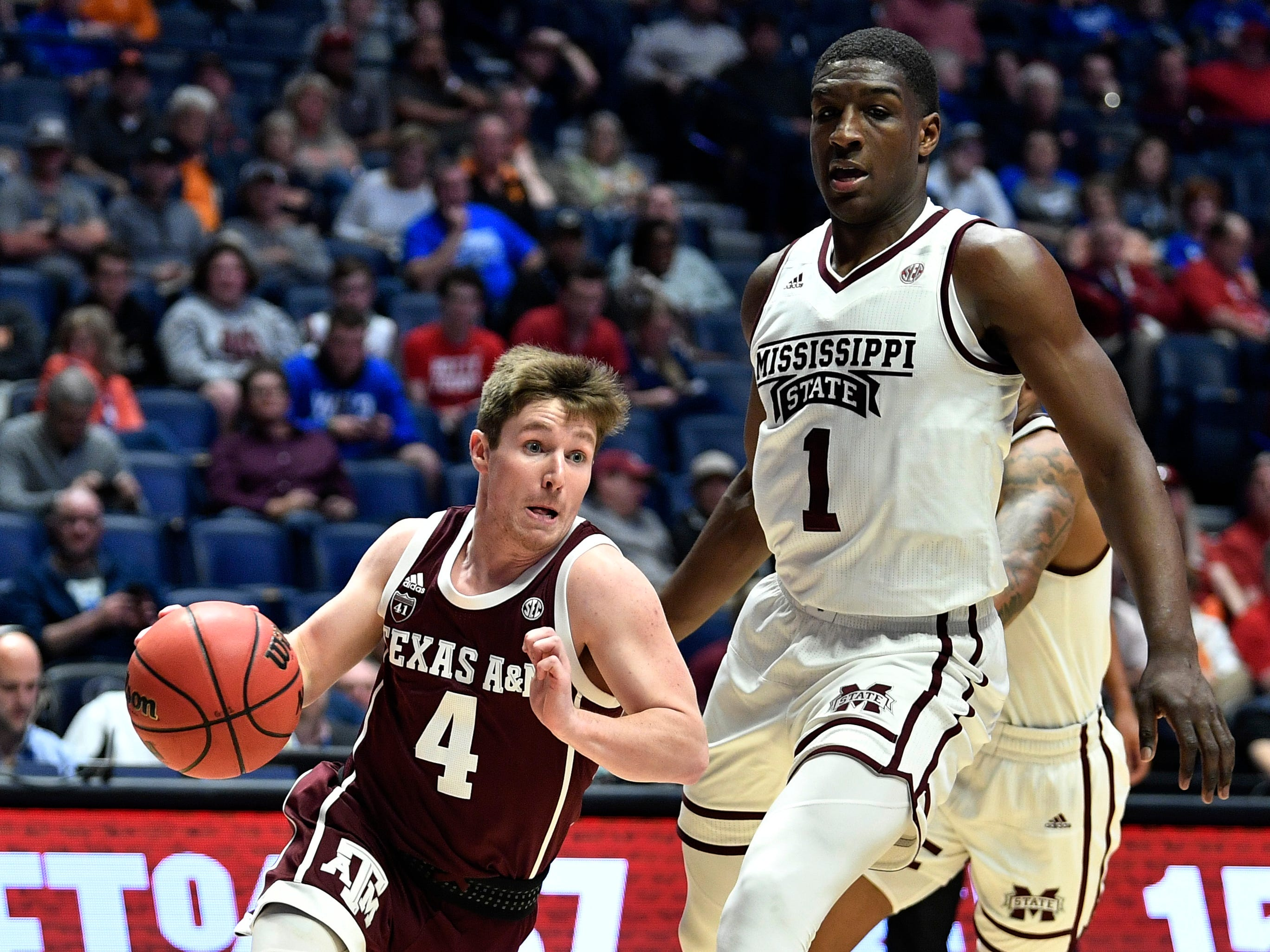 Texas A&M guard Mark French (4) moves the ball defended by Mississippi State forward Reggie Perry (1) during the first half of the SEC Men's Basketball Tournament game at Bridgestone Arena in Nashville, Tenn., Thursday, March 14, 2019.