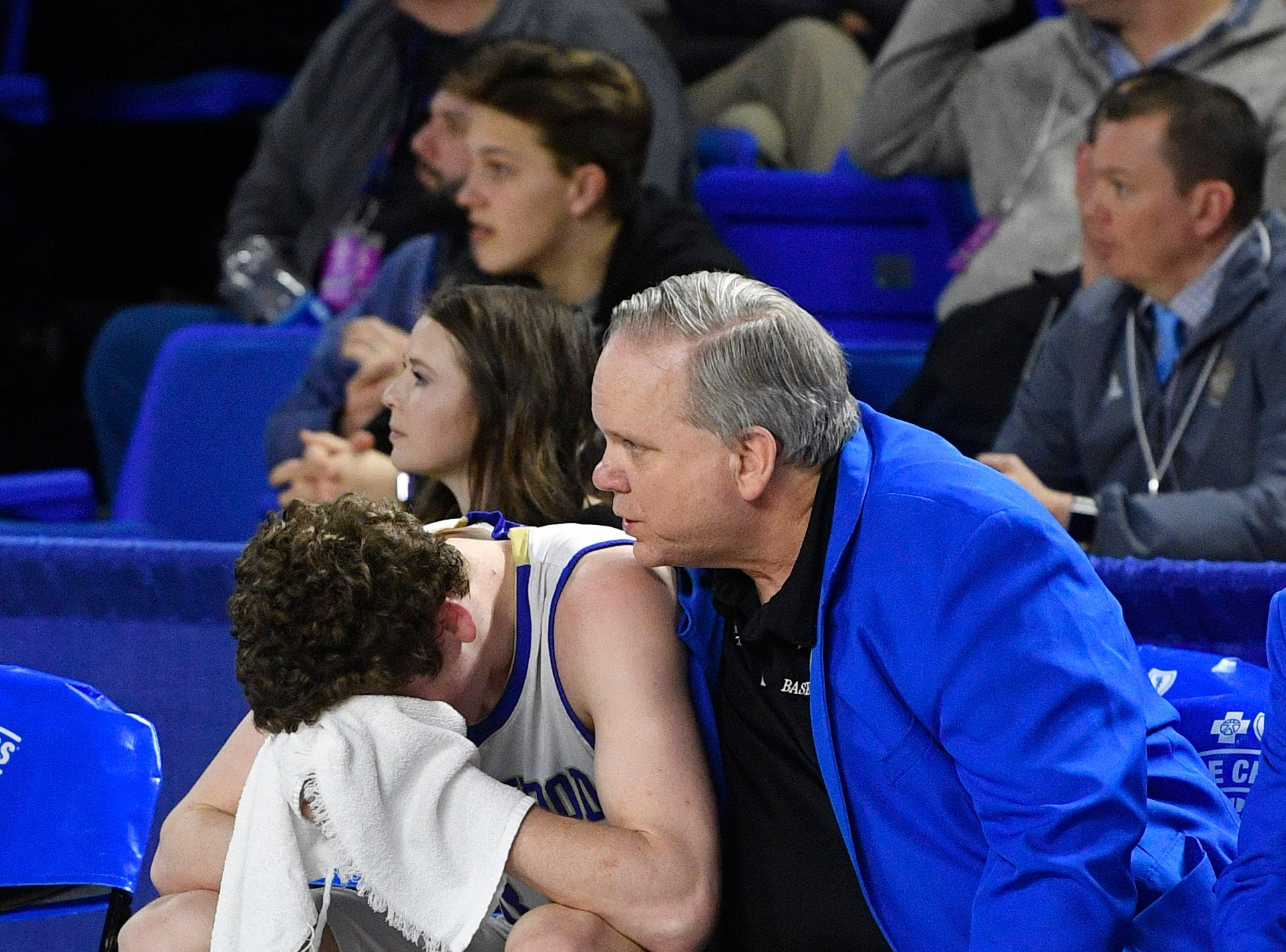 Brentwood head coach Greg Shirley tries to console Ben Mills (34) after Brentwood lost 46-42 to Memphis East in the TSSAA Class AAA semifinal  Friday, March 15, 2019, in Murfreesboro, Tenn.