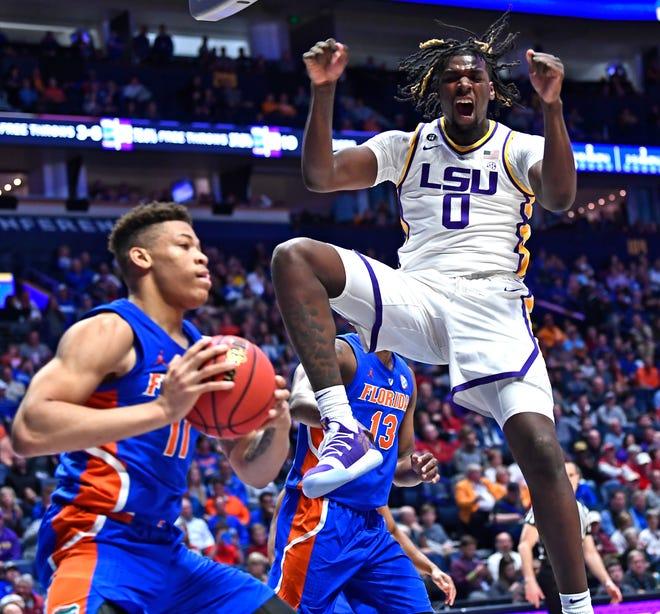 LSU forward Naz Reid (0) celebrates a dunk during the second half of the SEC Men's Basketball Tournament game at Bridgestone Arena in Nashville, Tenn., Friday, March 15, 2019.