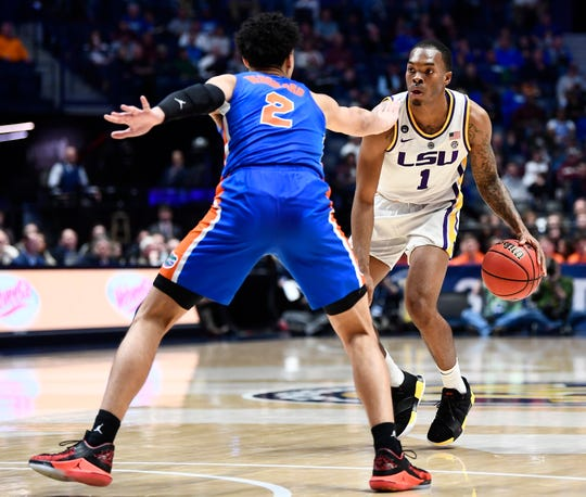LSU guard Javonte Smart (1) moves the ball defended by Florida guard Andrew Nembhard (2) during the second half of the SEC Men's Basketball Tournament game at Bridgestone Arena in Nashville, Tenn., Friday, March 15, 2019.