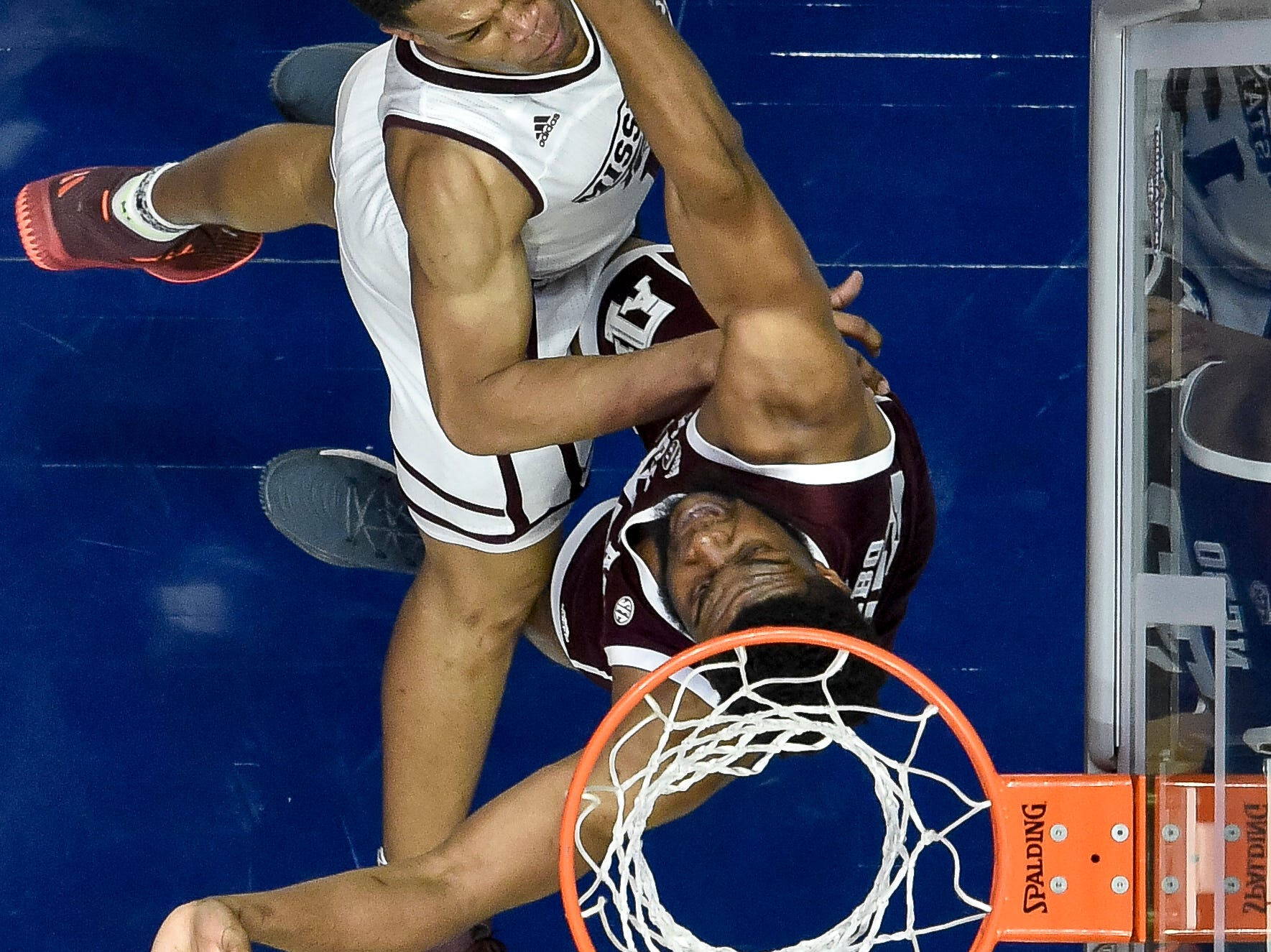 Mississippi State guard Robert Woodard (12) has his shoit blocked by Texas A&M forward Josh Nebo (32) during the first half of the SEC Men's Basketball Tournament game at Bridgestone Arena in Nashville, Tenn., Thursday, March 14, 2019.