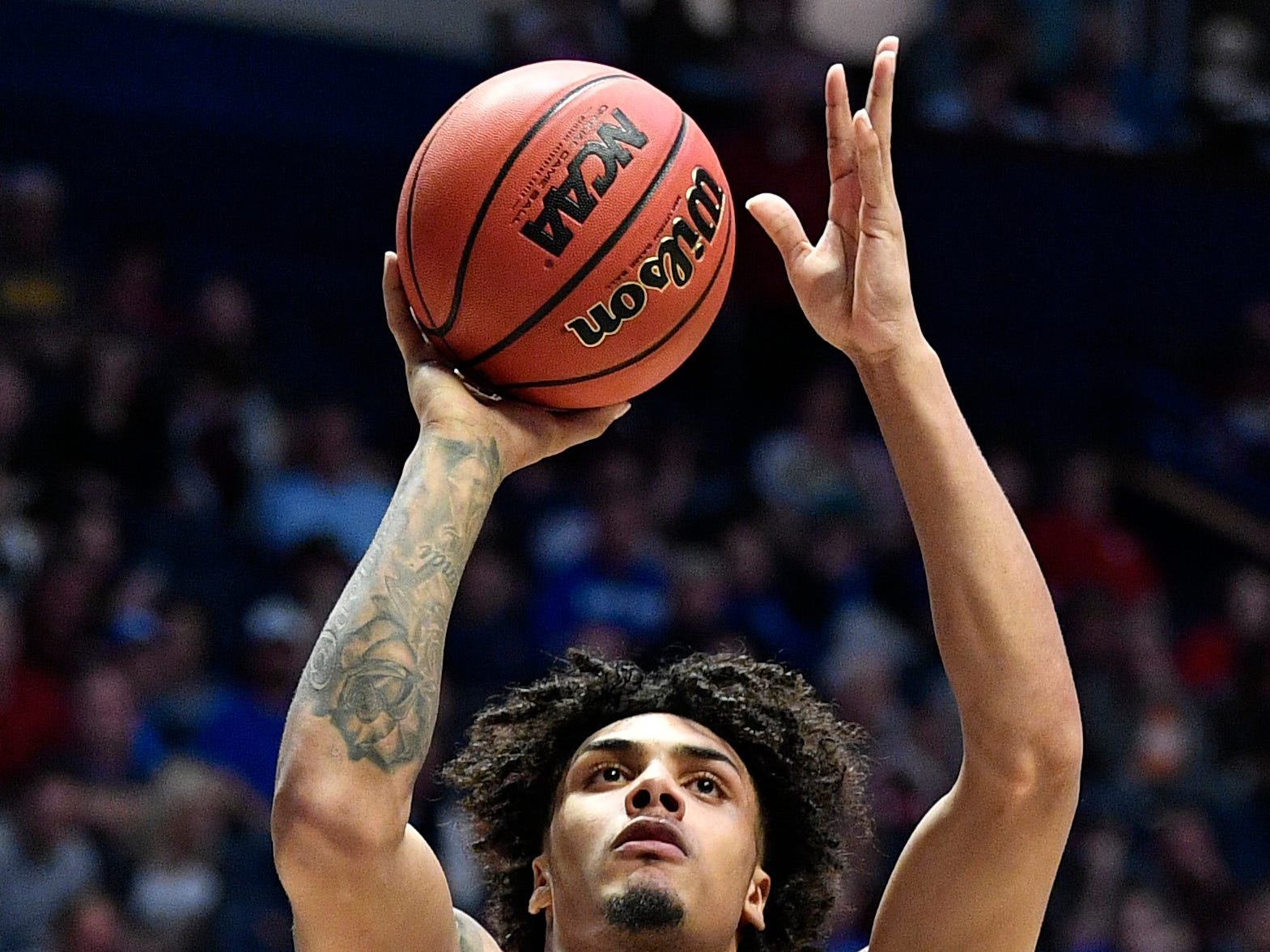 Texas A&M guard Brandon Mahan (13) takes a shot during the first half of the SEC Men's Basketball Tournament game  against Mississippi State at Bridgestone Arena in Nashville, Tenn., Thursday, March 14, 2019.