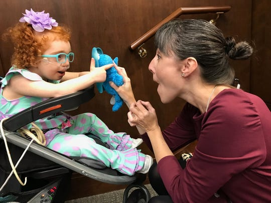 Asher Gross (left) plays with Sara Scott, a regional organizer for Family Voices of Tennessee, before a House TennCare Subcommittee meeting on Wednesday,  March 13, 2019. Six-year-old Asher has severe disabilities. Her mom, Michelle Gross, was there to advocate on behalf of other Tennessee children like her who can't qualify for Medicaid coverage.