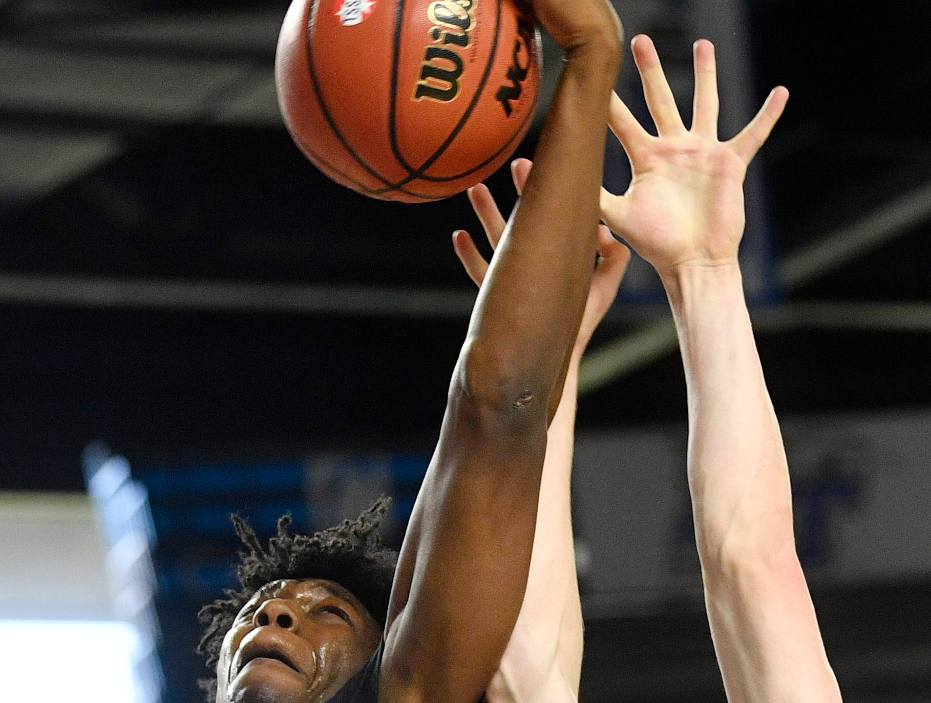 Memphis East's James Wiseman (32) out jumps Brentwood's Ben Mills (34) for a rebound as Brentwood plays Memphis East in the TSSAA Class AAA semifinal  Friday, March 15, 2019, in Murfreesboro, Tenn.