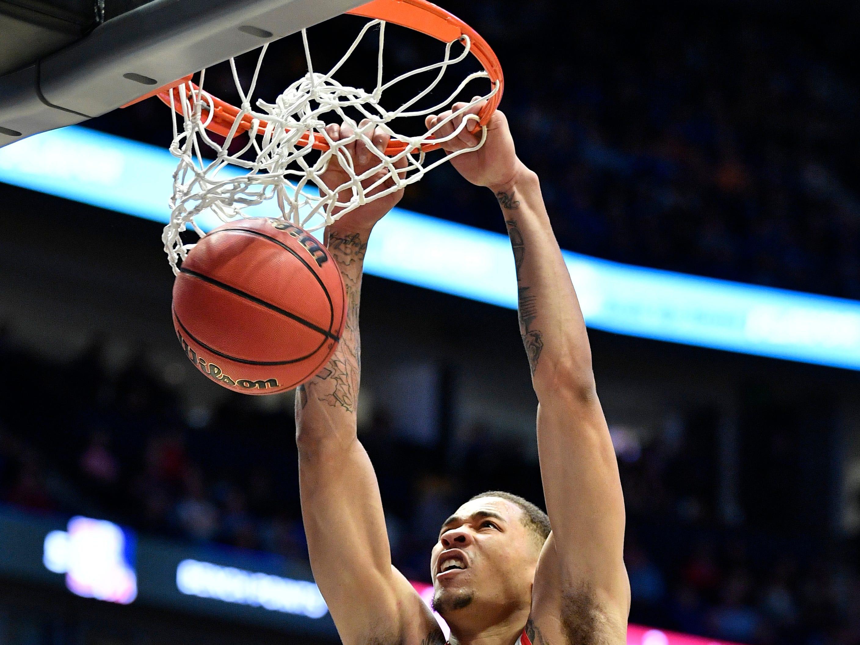 Ole Miss forward KJ Buffen (14) dunks during the second half of the SEC Men's Basketball Tournament game at Bridgestone Arena in Nashville, Tenn., Thursday, March 14, 2019.