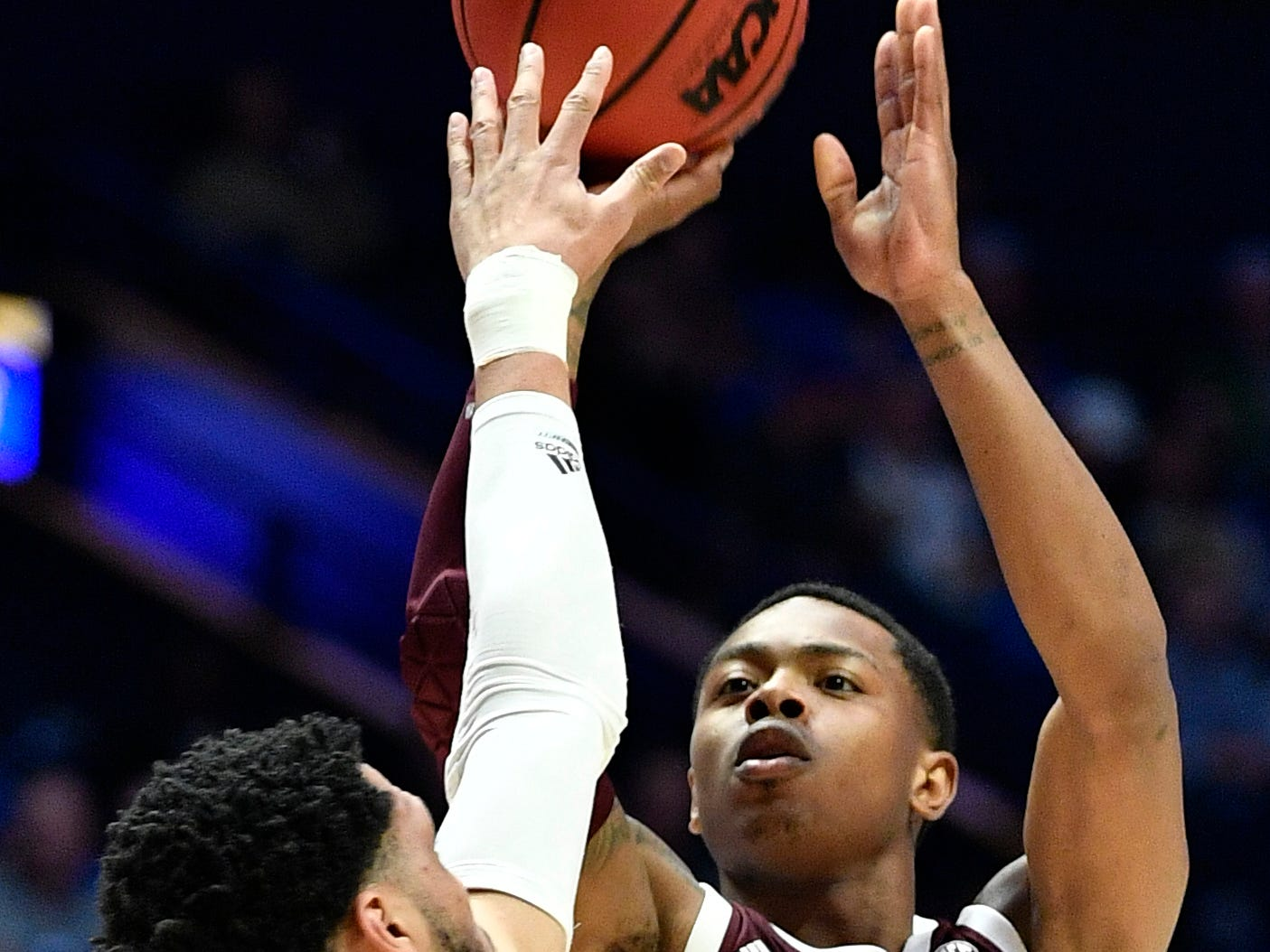 Texas A&M guard Wendell Mitchell (11) shoots defended by Mississippi State guard Quinndary Weatherspoon (11) during the first half of the SEC Men's Basketball Tournament game at Bridgestone Arena in Nashville, Tenn., Thursday, March 14, 2019.