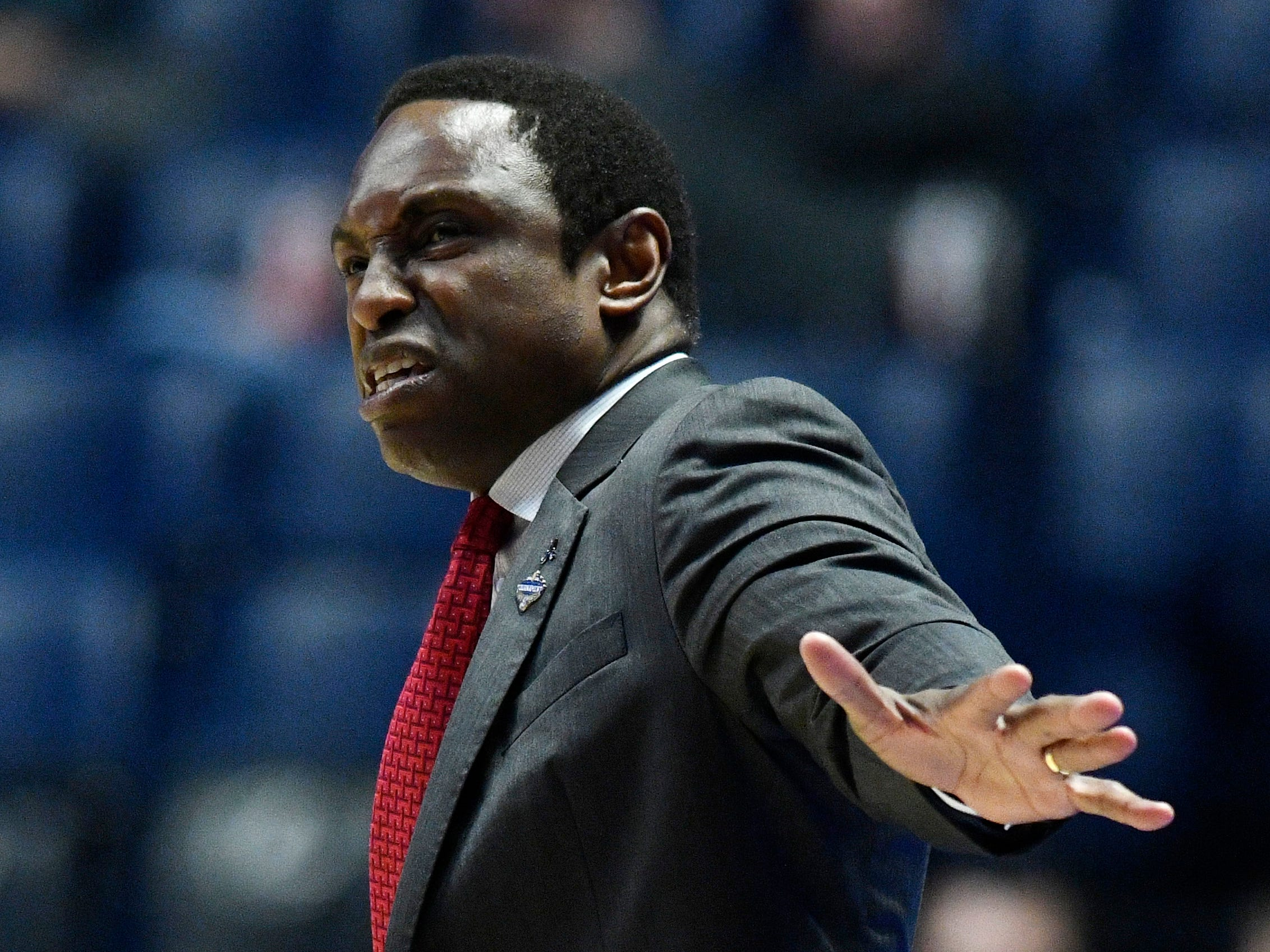 Alabama head coach Avery Johnson instructs his team during the first half of the SEC Men's Basketball Tournament game at Bridgestone Arena in Nashville, Tenn., Thursday, March 14, 2019.