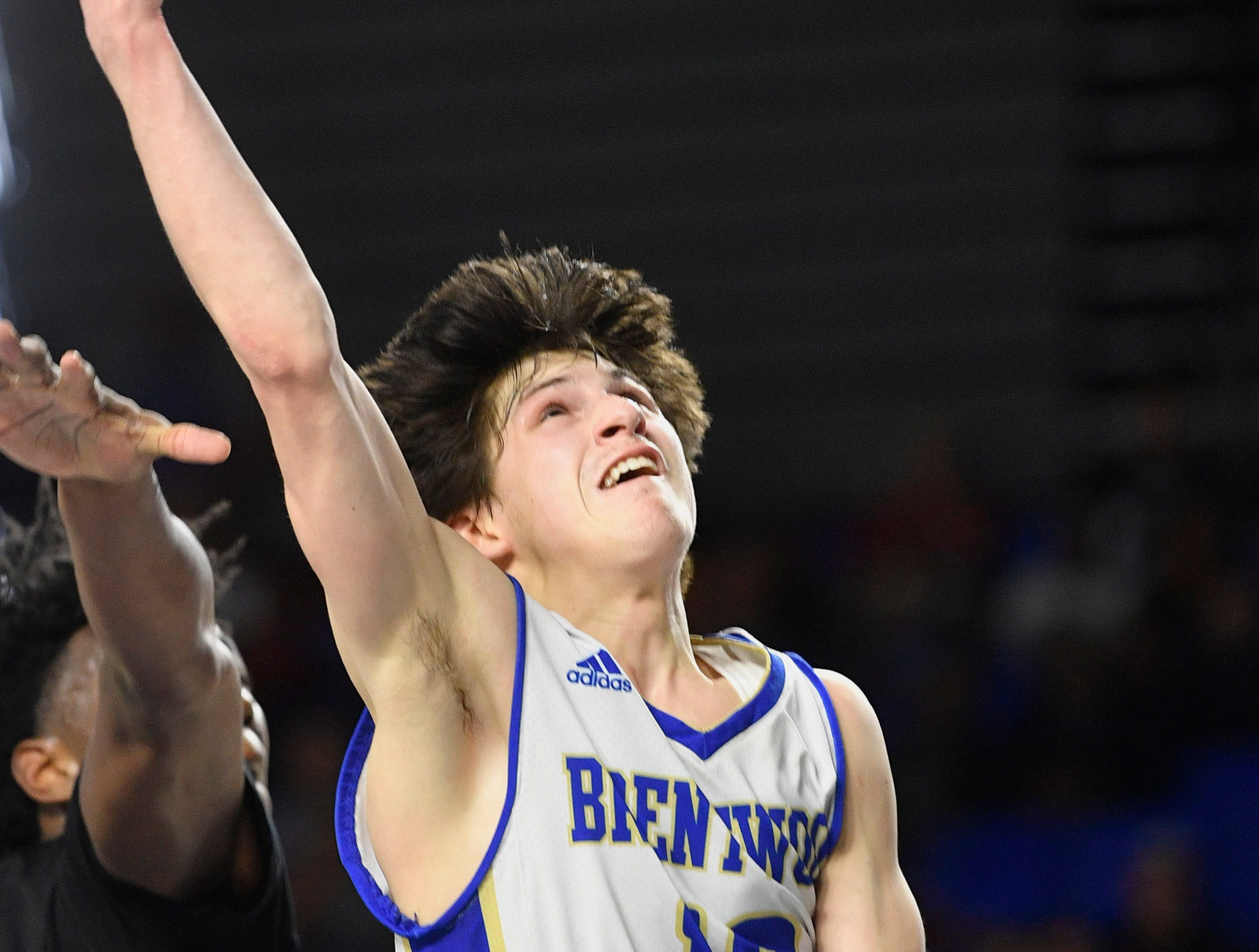 Brentwood's Preston Moore (12) goes up for a shot as Brentwood plays Memphis East in the TSSAA Class AAA semifinal  Friday, March 15, 2019, in Murfreesboro, Tenn.
