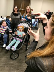 Sarah Sampson, deputy director of the Tennessee Disability Coalition, takes a photo of Rosalie Howes and her 7-year-old son, Hyrum, and Michelle Gross and her 6-year-old daughter, Asher, after a House TennCare Subcommittee hearing on Wednesday, March 13, 2019. The moms were there advocating for a pathway to Medicaid for children with severe disabilities living at home who don't qualify because their parents' income is too high.