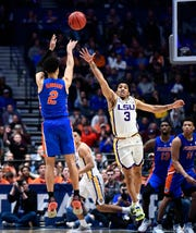Florida guard Andrew Nembhard (2) shoots the game-winning three pointer over LSU guard Tremont Waters (3) late in the second half of the SEC Men's Basketball Tournament game at Bridgestone Arena in Nashville, Tenn., Friday, March 15, 2019.