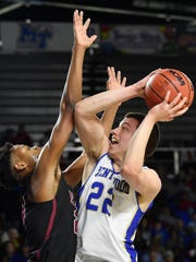 Brentwood's Harry Lackey (22) takes a shot as Brentwood plays Memphis East in the TSSAA Class AAA semifinal  Friday, March 15, 2019, in Murfreesboro, Tenn.