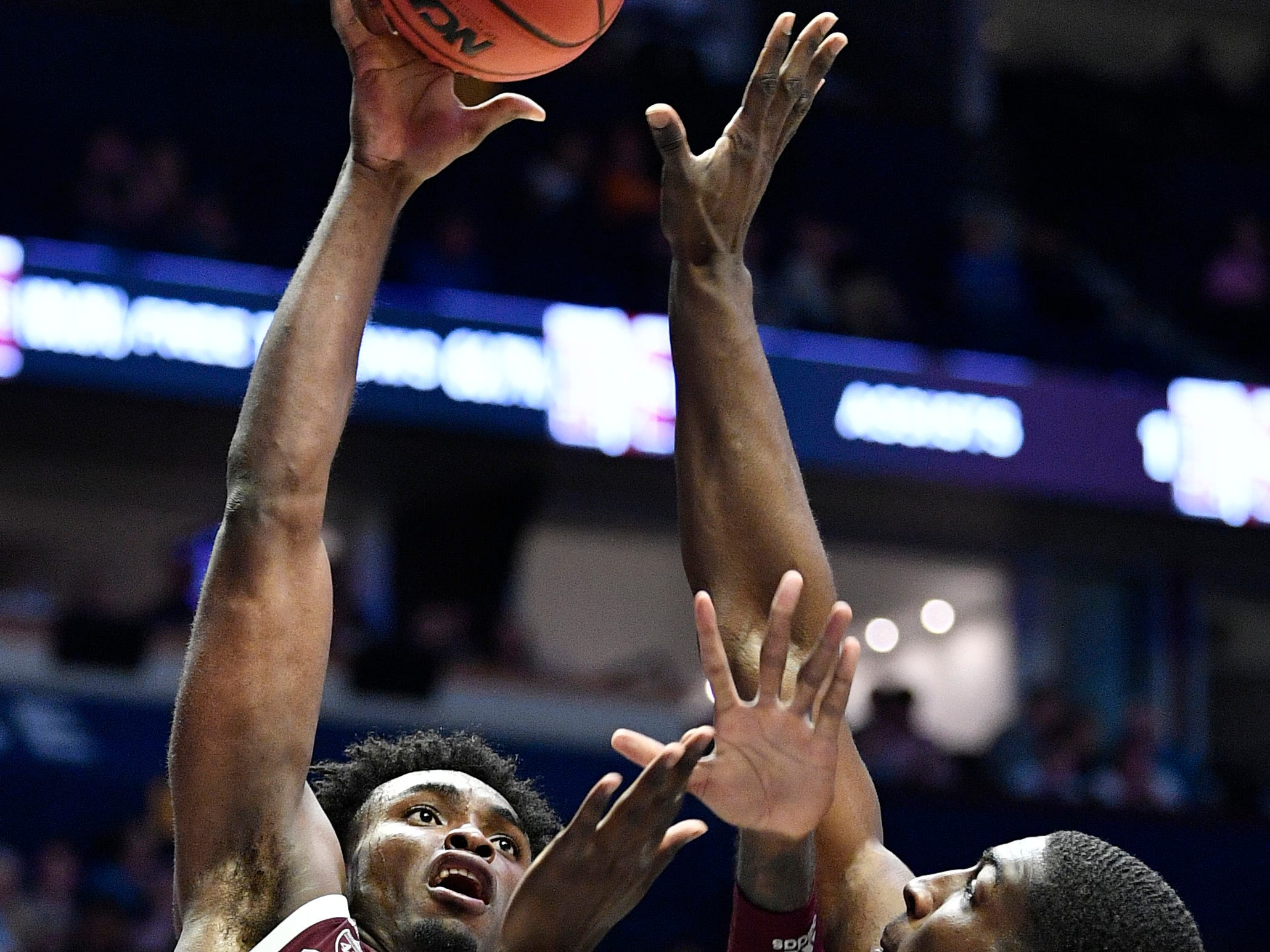 Texas A&M forward Christian Mekowulu (21) shoots defended by Mississippi State forward Reggie Perry (1) during the first half of the SEC Men's Basketball Tournament game at Bridgestone Arena in Nashville, Tenn., Thursday, March 14, 2019.
