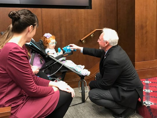 """State Rep. Ron Travis (R-Dayton) says hello to 6-year-old Asher Gross during a House TennCare Subcommittee hearing on Wednesday, March 13, 2019. Travis has an 18-month granddaughter with disabilities. """"What these guys are going through is tough,"""" he said during the subcommittee hearing. """"Every single day, every single night, they have an issue."""""""