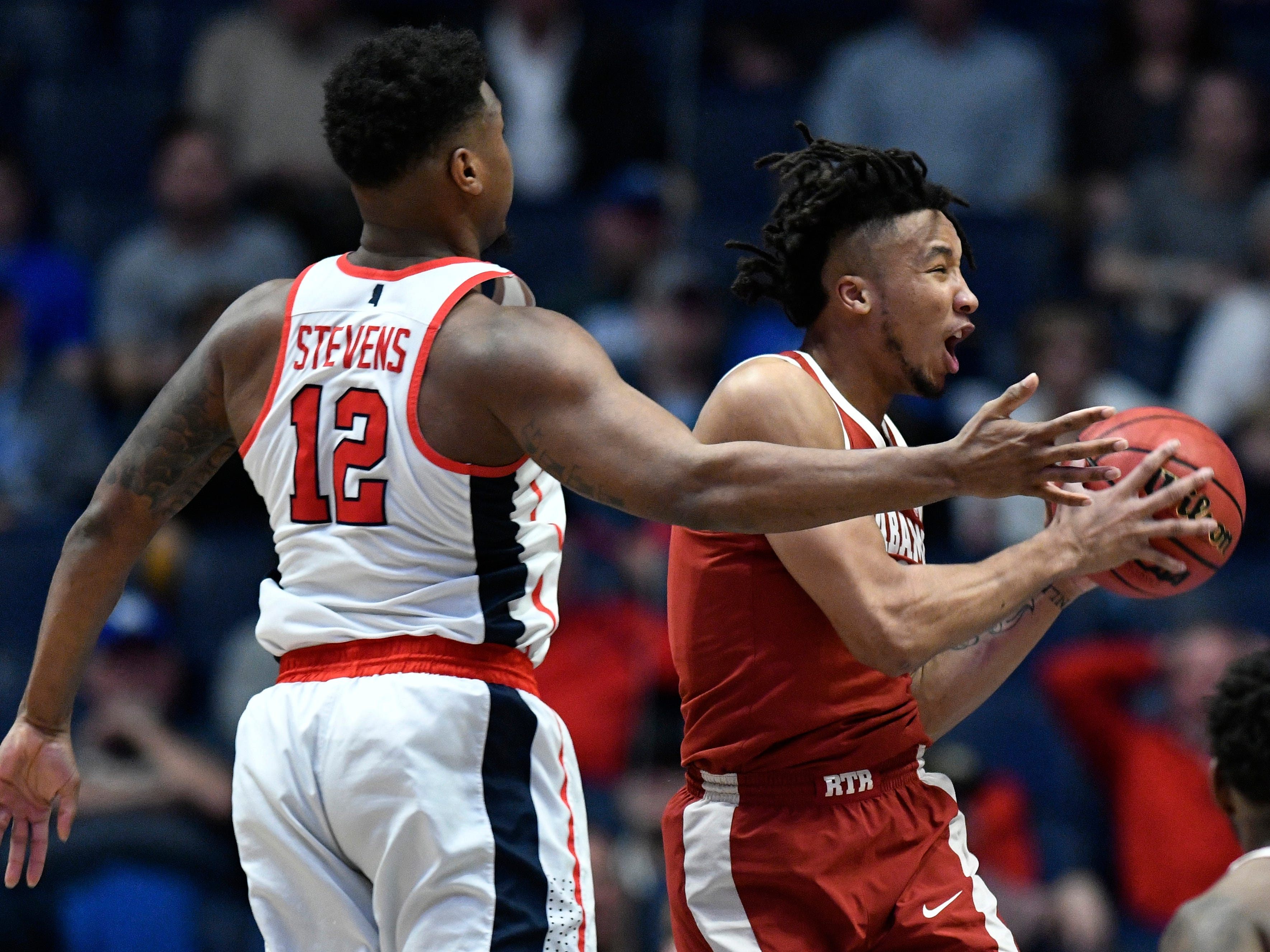 Alabama guard Dazon Ingram (12) takes it to the basket defended by Ole Miss forward Bruce Stevens (12) during the second half of the SEC Men's Basketball Tournament game at Bridgestone Arena in Nashville, Tenn., Thursday, March 14, 2019.