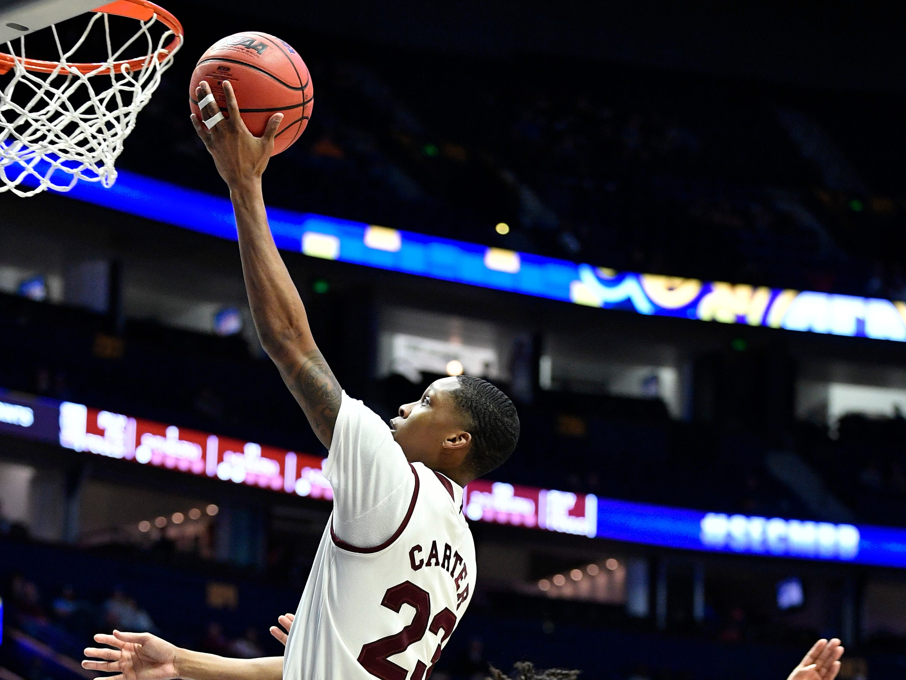 Mississippi State guard Tyson Carter (23) goes in for a shot during the second half of the SEC Men's Basketball Tournament game at Bridgestone Arena in Nashville, Tenn., Thursday, March 14, 2019.