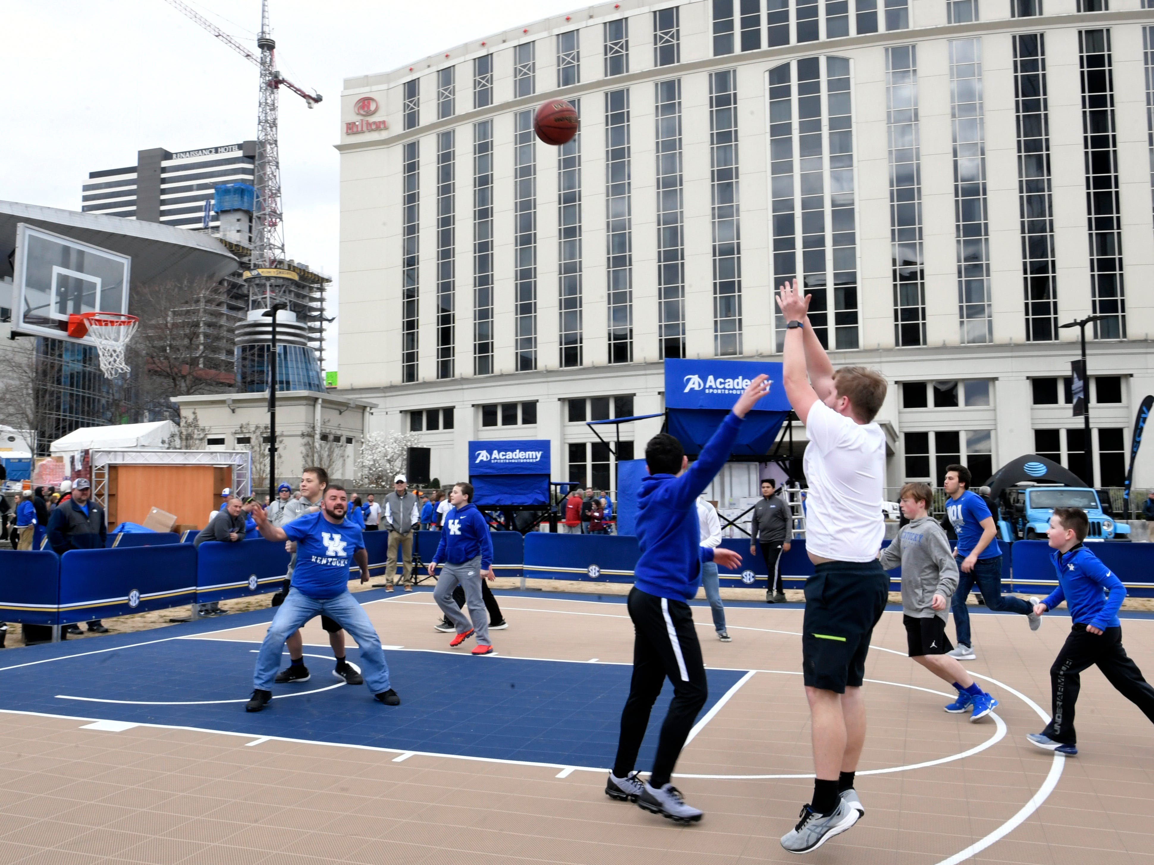 Kentucky fans play a game at the SEC Men's Basketball Tournament's Fanfare at Music City Walk of Fame Park in Nashville on Friday, March 15, 2019.