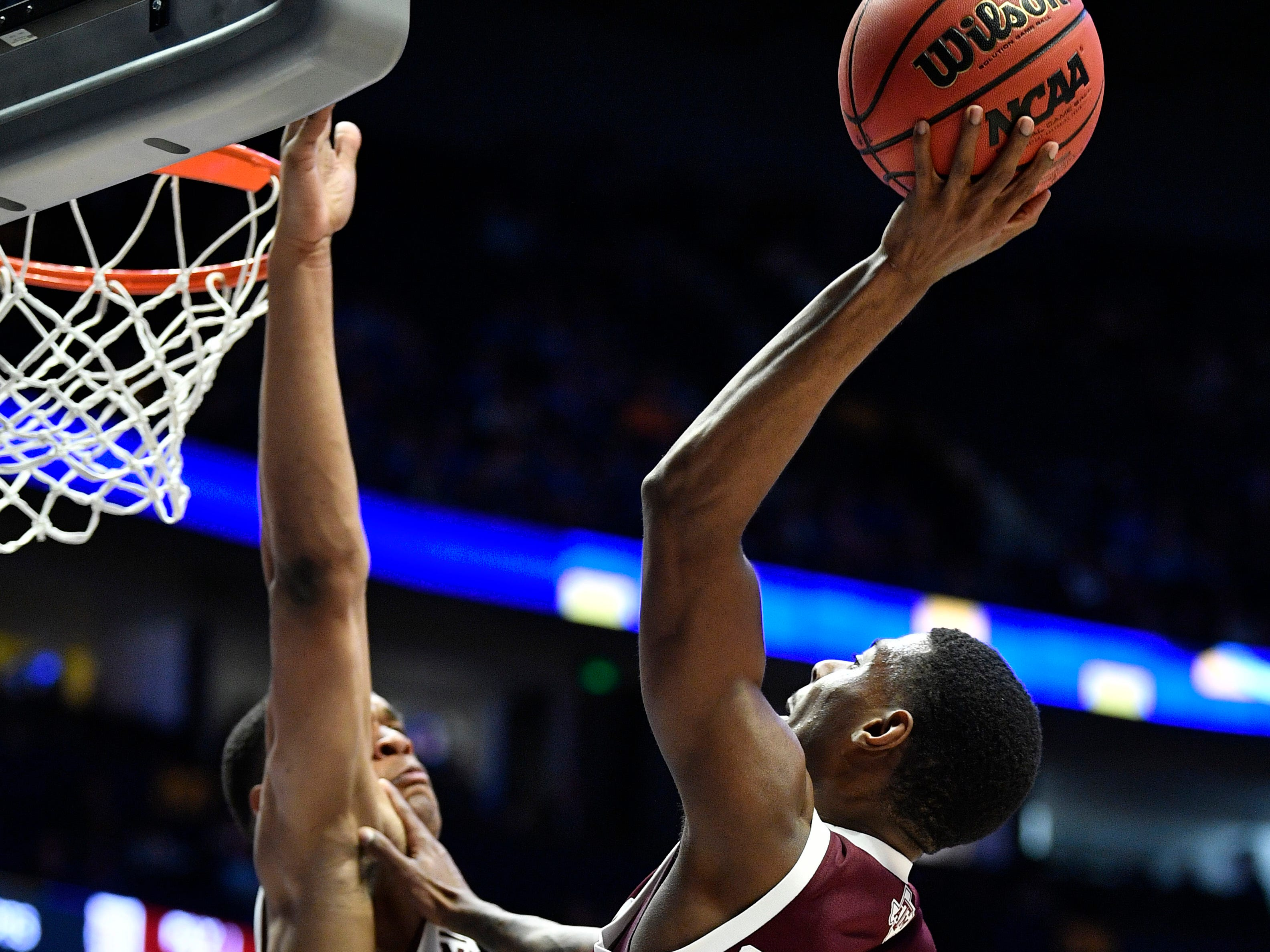 Texas A&M guard Jay Jay Chandler (0) shoots defended by Mississippi State guard Robert Woodard (12) during the first half of the SEC Men's Basketball Tournament game at Bridgestone Arena in Nashville, Tenn., Thursday, March 14, 2019.