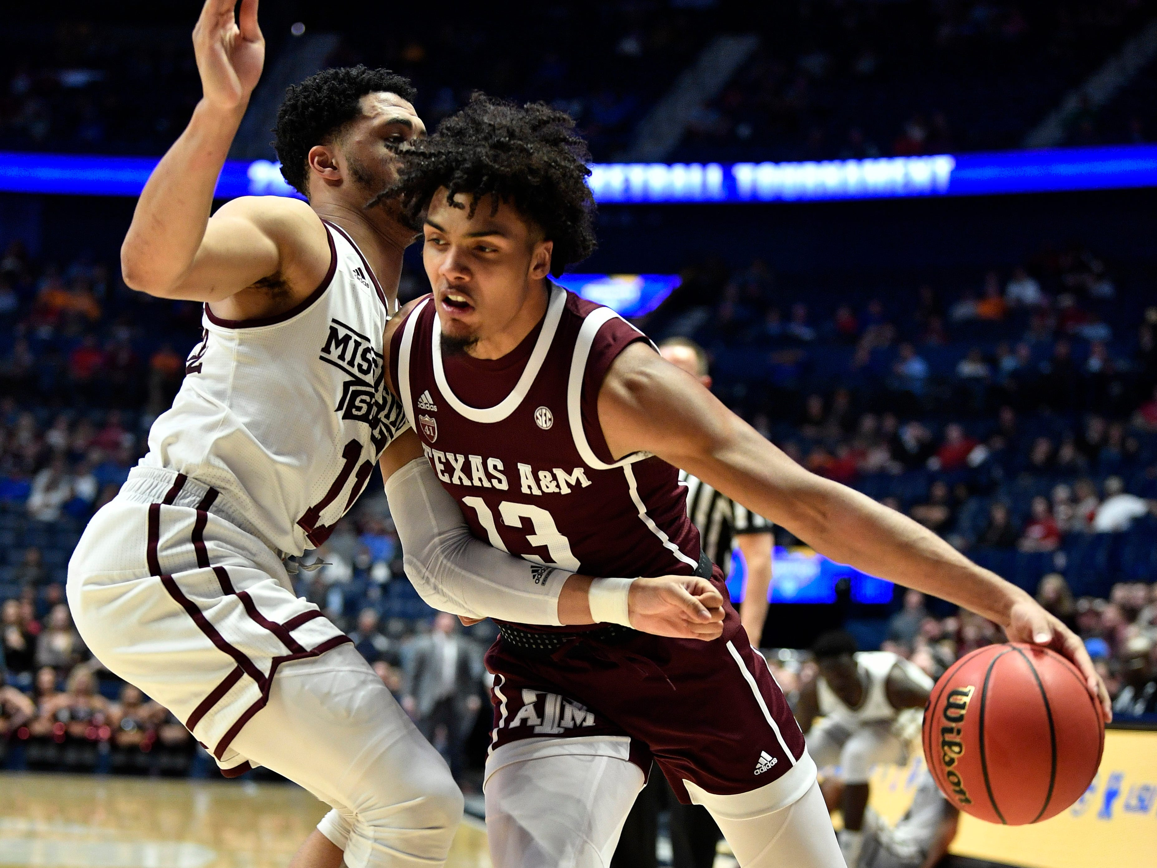 Texas A&M guard Brandon Mahan (13) moves the ball defended by Mississippi State guard Quinndary Weatherspoon (11) during the first half of the SEC Men's Basketball Tournament game at Bridgestone Arena in Nashville, Tenn., Thursday, March 14, 2019.