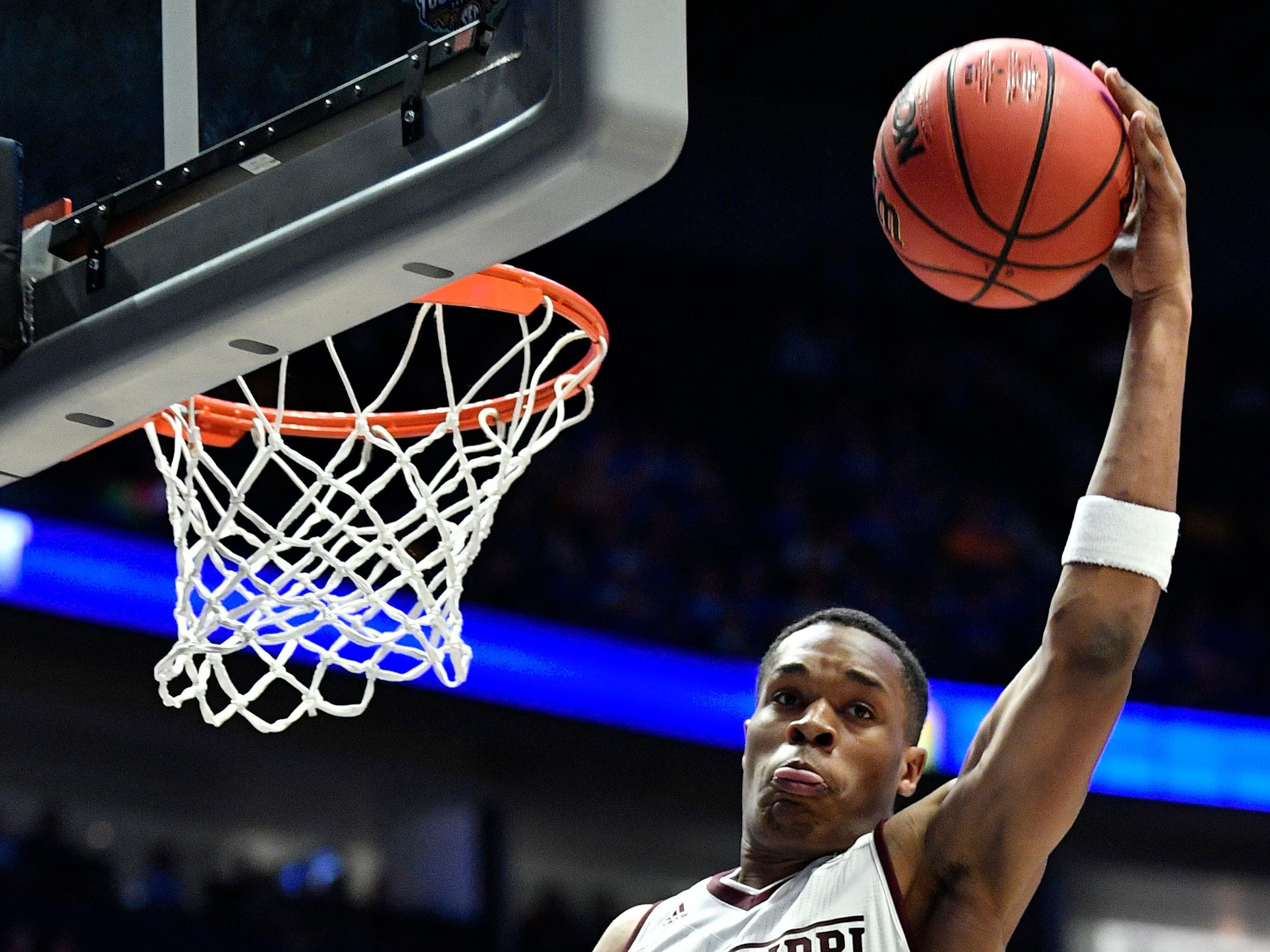 Mississippi State guard Robert Woodard (12) grabs a rebounc during the first half of the SEC Men's Basketball Tournament game with Texas A&M at Bridgestone Arena in Nashville, Tenn., Thursday, March 14, 2019.