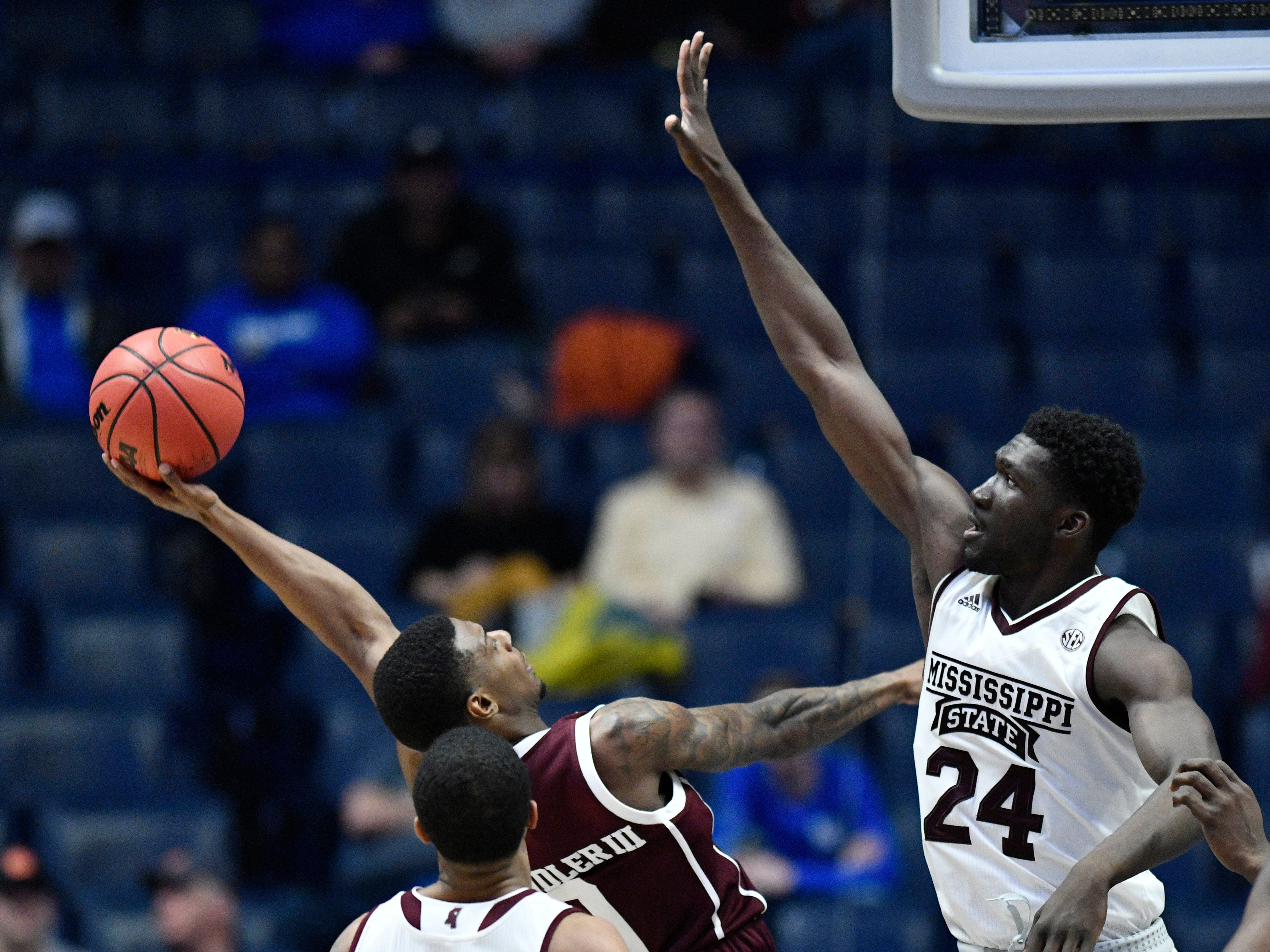 Texas A&M guard Jay Jay Chandler (0) shoots defended by Mississippi State forward Abdul Ado (24) during the secibd half of the SEC Men's Basketball Tournament game at Bridgestone Arena in Nashville, Tenn., Thursday, March 14, 2019.