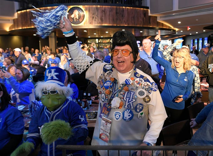 Kentucky fan Rick Cothern cheers wearing an Elvis wig during a pep rally at Wildhorse Saloon before a game at the SEC Men's Basketball Tournament in Nashville on Friday, March 15, 2019.