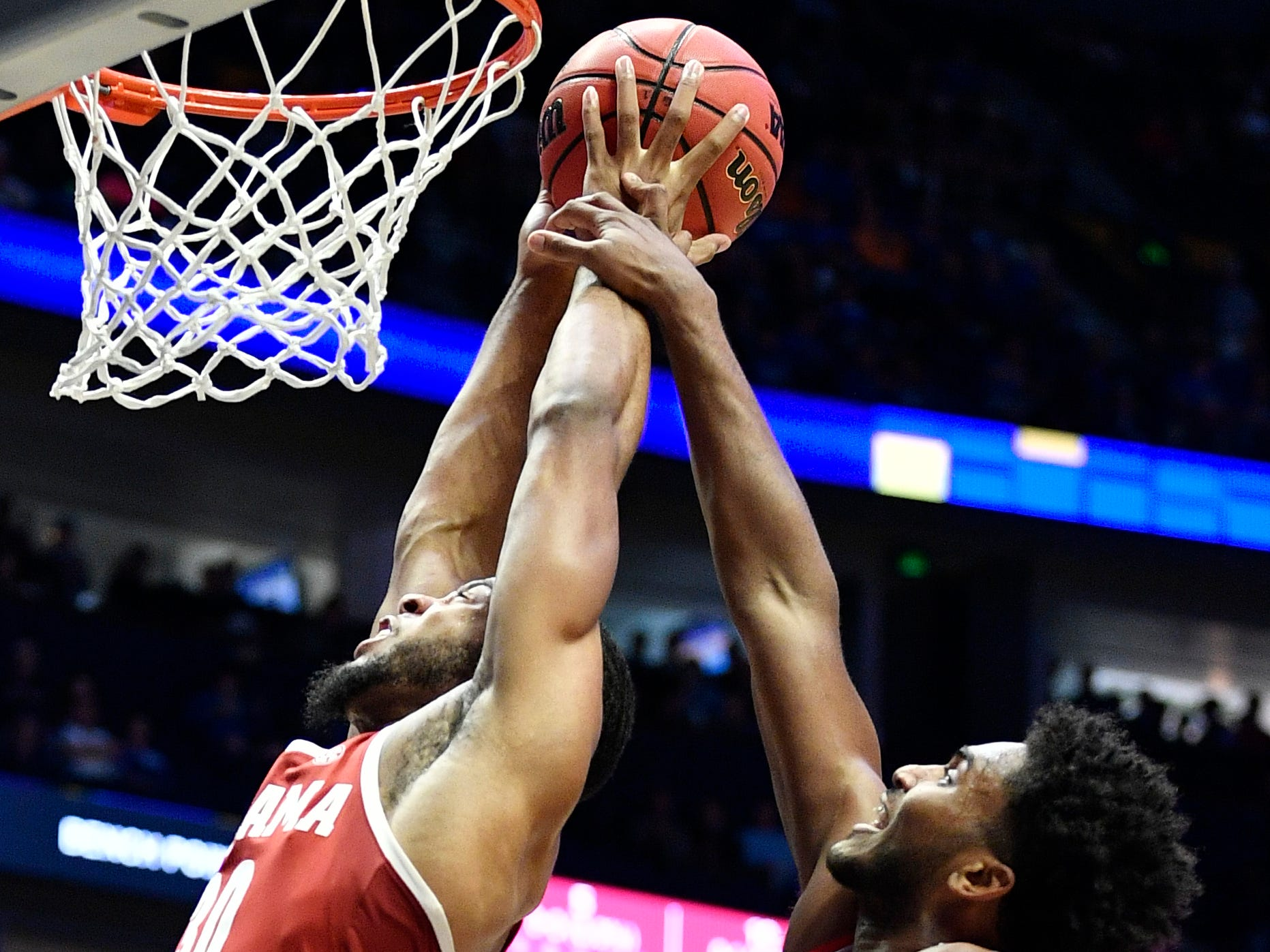Ole Miss guard/forward Blake Hinson (0) fouls Alabama forward Galin Smith (30) during the first half of the SEC Men's Basketball Tournament game at Bridgestone Arena in Nashville, Tenn., Thursday, March 14, 2019.