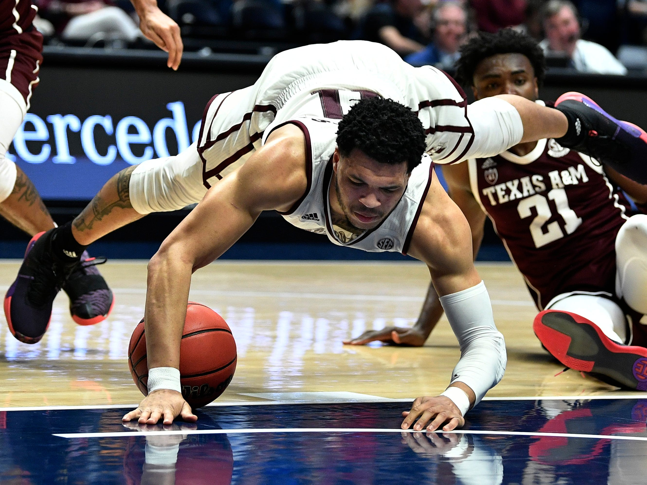 Mississippi State guard Quinndary Weatherspoon (11) gets tripped up during the first half of the SEC Men's Basketball Tournament game against Texas A&M at Bridgestone Arena in Nashville, Tenn., Thursday, March 14, 2019.