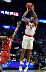 Ole Miss guard/forward Blake Hinson (0) shoots over Alabama guard Kira Lewis Jr. (2) during the second half of the SEC Men's Basketball Tournament game at Bridgestone Arena in Nashville, Tenn., Thursday, March 14, 2019.