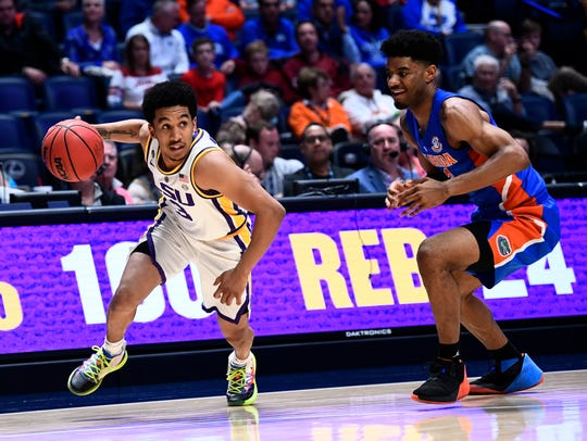LSU guard Tremont Waters (3) moves the ball defended by Florida guard Jalen Hudson (3) during the second half of the SEC Men's Basketball Tournament game at Bridgestone Arena in Nashville, Tenn., Friday, March 15, 2019.