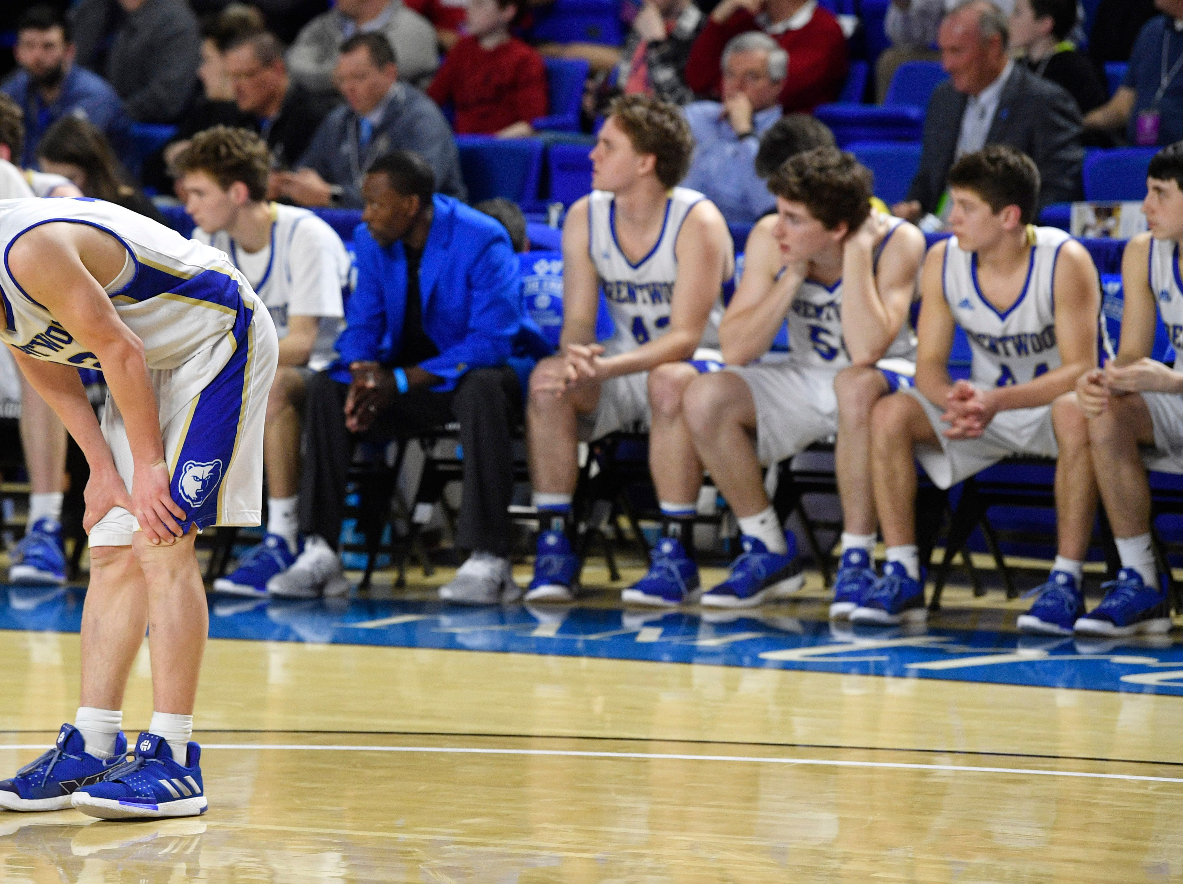 Brentwood Preston Moore (12) takes a moment to compose himself during the last seconds of the game as as Brentwood loses to Memphis East 46-42 in the TSSAA Class AAA semifinal  Friday, March 15, 2019, in Murfreesboro, Tenn.
