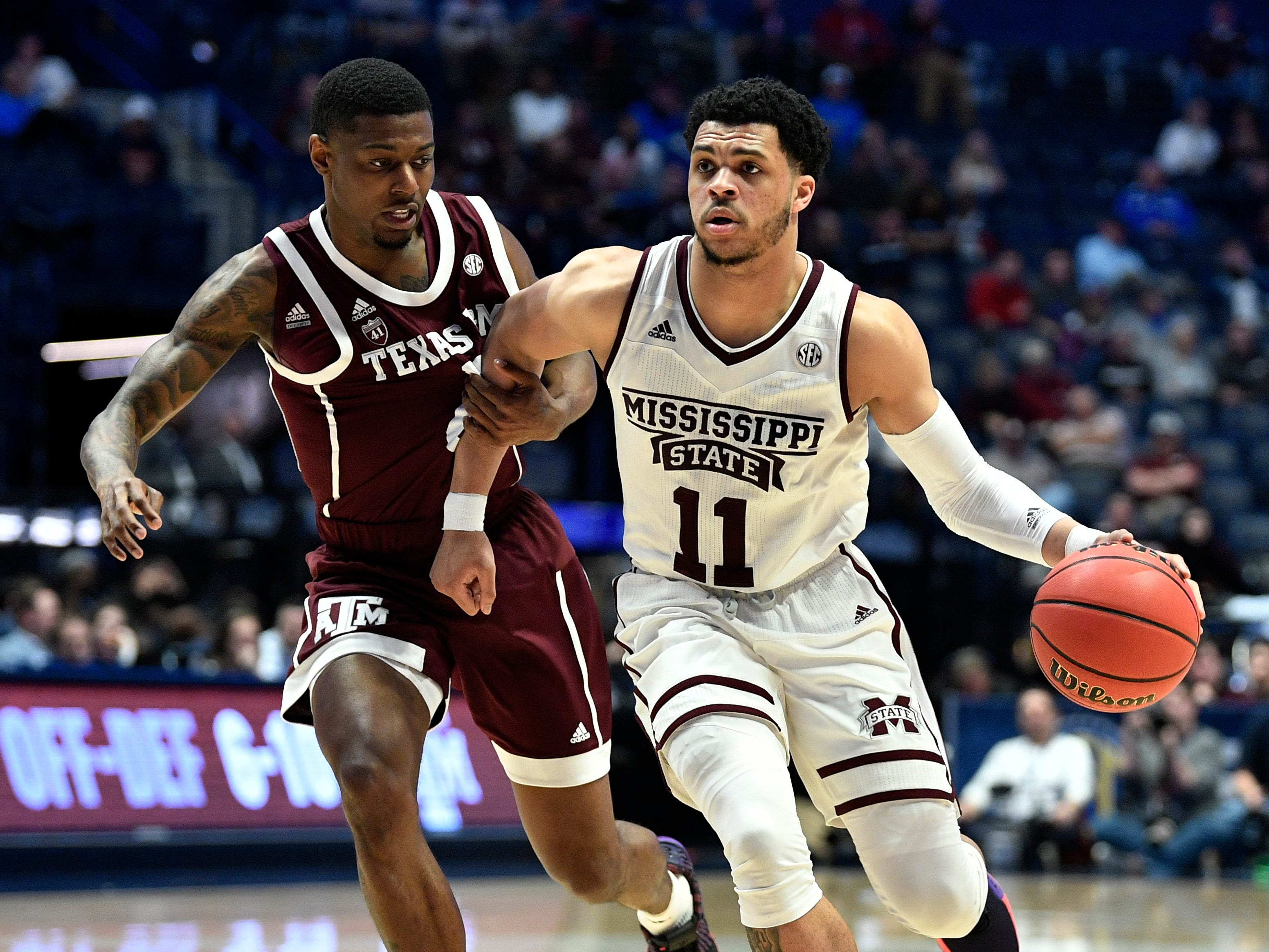 Mississippi State guard Quinndary Weatherspoon (11) moves the ball as Texas A&M guard Jay Jay Chandler (0) hangs on during the second half of the SEC Men's Basketball Tournament game at Bridgestone Arena in Nashville, Tenn., Thursday, March 14, 2019.