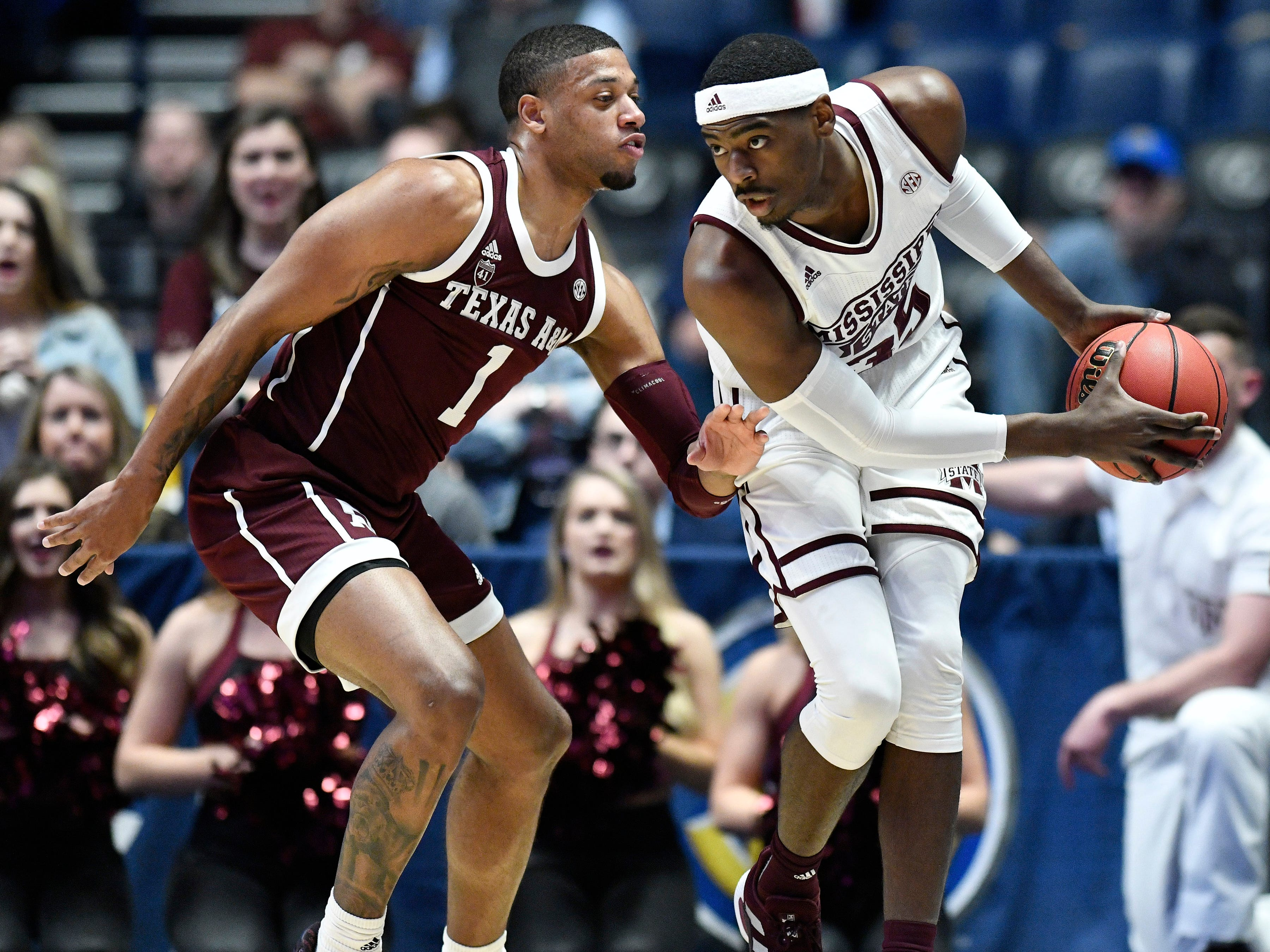 Mississippi State forward Aric Holman (35) moves the ball defended by Texas A&M guard Savion Flagg (1) during the first half of the SEC Men's Basketball Tournament game at Bridgestone Arena in Nashville, Tenn., Thursday, March 14, 2019.