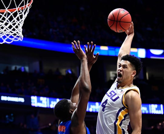LSU guard Skylar Mays (4) slams the ball ove rFlorida center Kevarrius Hayes (13) during the second half of the SEC Men's Basketball Tournament game at Bridgestone Arena in Nashville, Tenn., Friday, March 15, 2019.