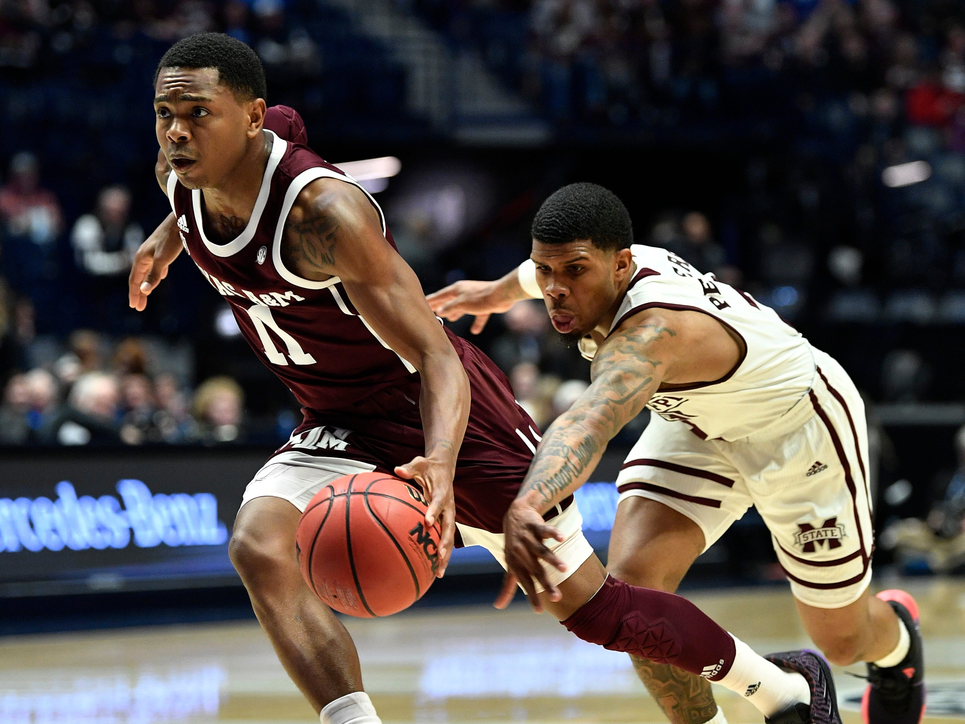 Texas A&M guard Wendell Mitchell (11) gets away from Mississippi State guard Lamar Peters (2) the first half of the SEC Men's Basketball Tournament game at Bridgestone Arena in Nashville, Tenn., Thursday, March 14, 2019.
