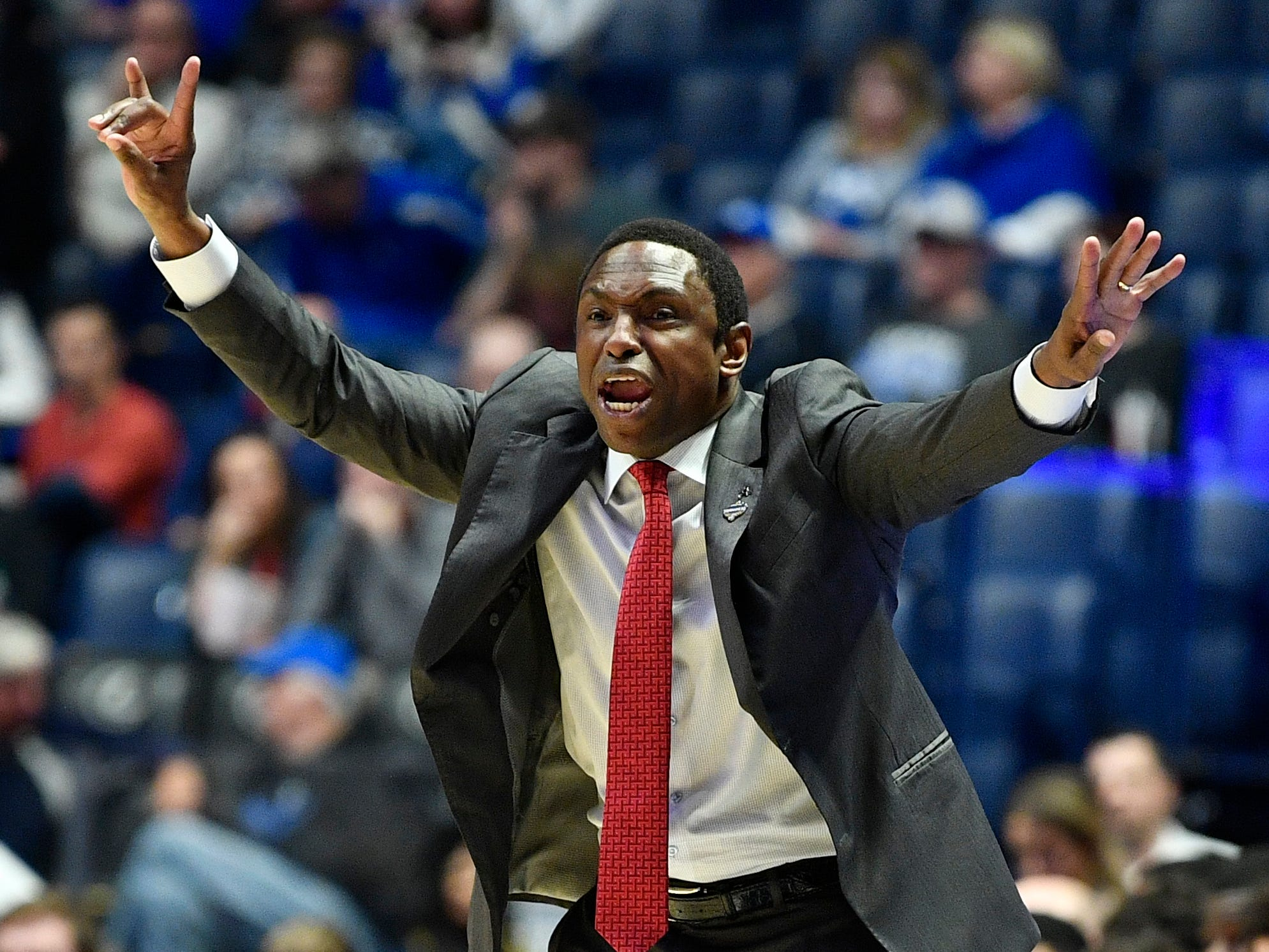 Alabama head coach Avery Johnson gives instructions from the sidelines during the first half of the SEC Men's Basketball Tournament game at Bridgestone Arena in Nashville, Tenn., Thursday, March 14, 2019.