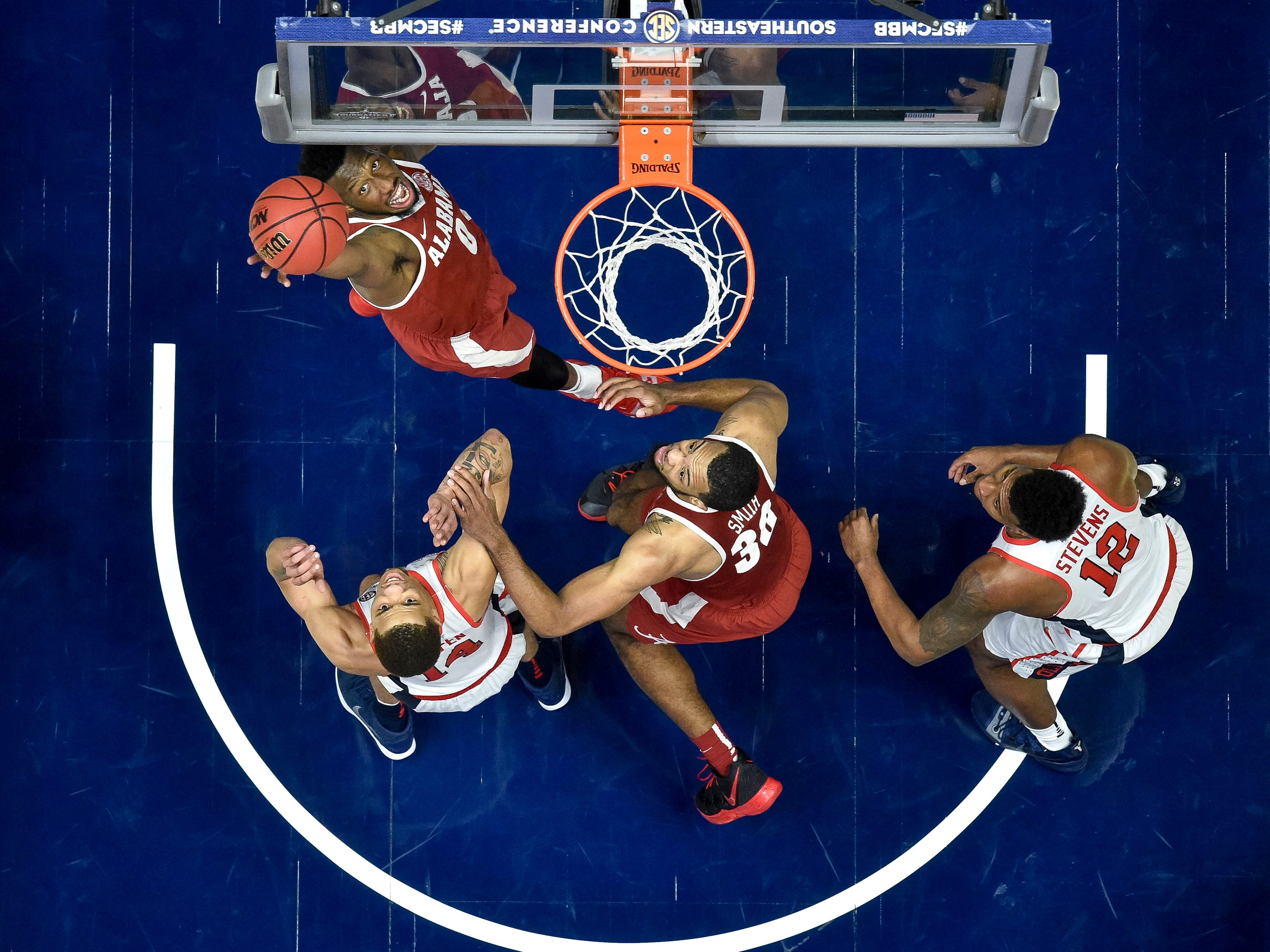 Alabama forward Donta Hall (0) shoots against Ole Miss during the second half of the SEC Men's Basketball Tournament game at Bridgestone Arena in Nashville, Tenn., Thursday, March 14, 2019.