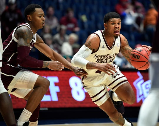 Mississippi State guard Lamar Peters (2) moves the ball defended by Texas A&M guard Wendell Mitchell (11) during the second half of the SEC Men's Basketball Tournament game at Bridgestone Arena in Nashville, Tenn., Thursday, March 14, 2019.